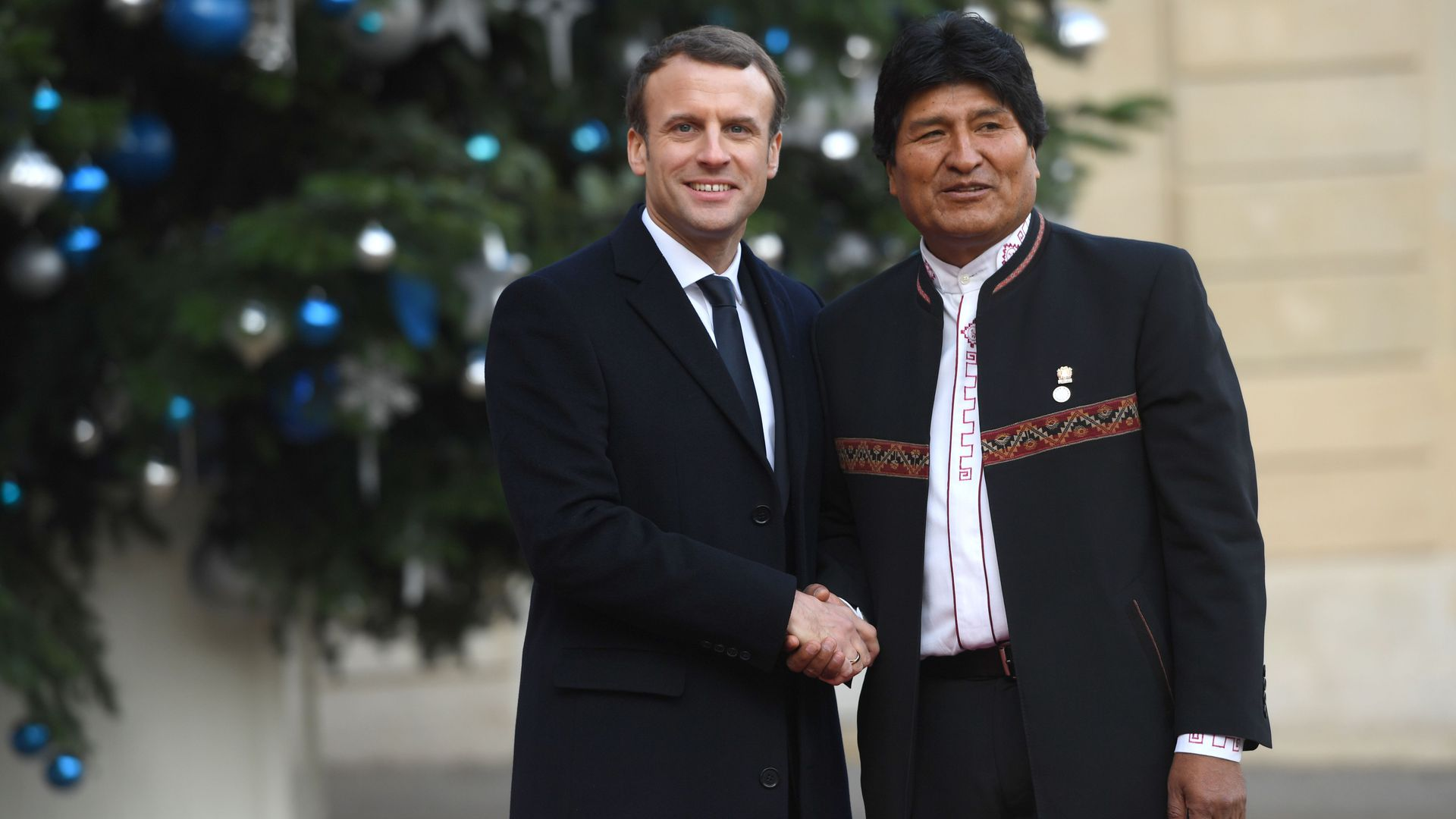 French President Emmanuel Macron greets Bolivian President Evo Morales upon his arrival at the Elysée palace on December 12, 2017.