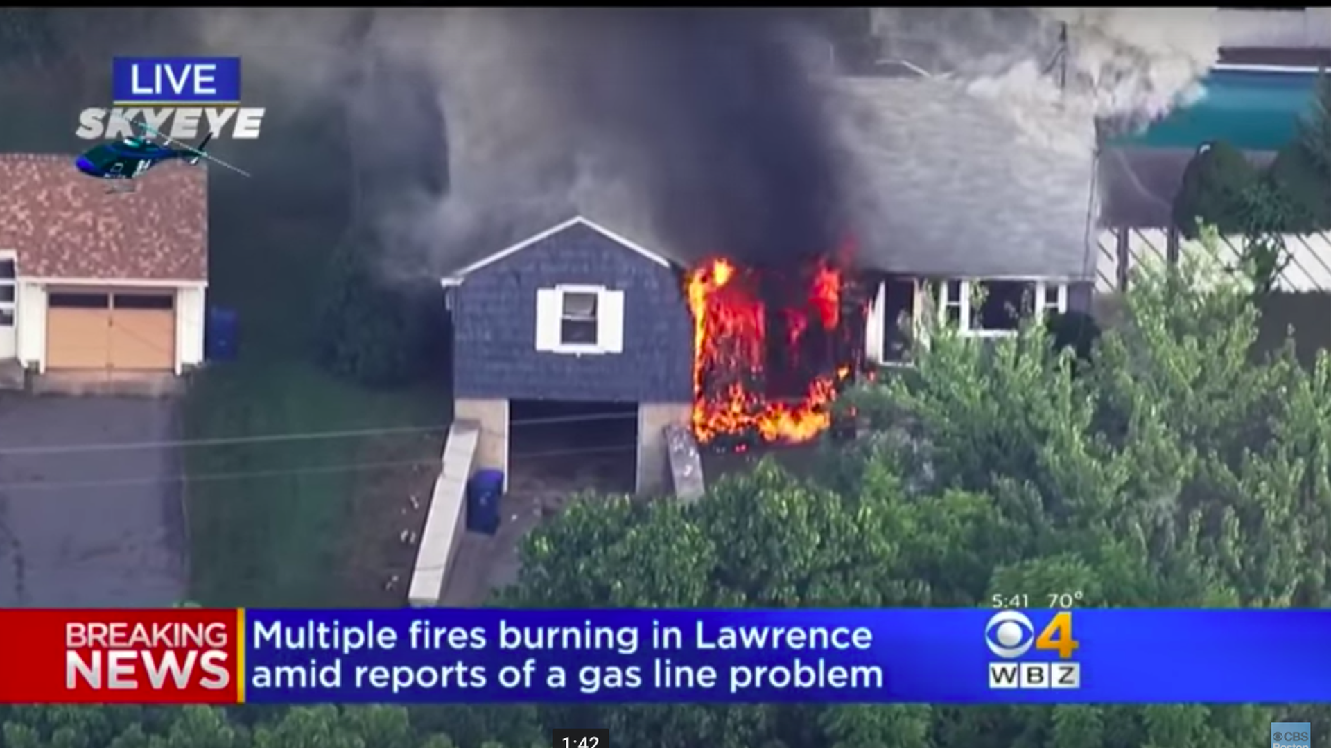 Flames consuming a home in Lawrence, Massachusetts. Photo via CBS Boston Youtube page.