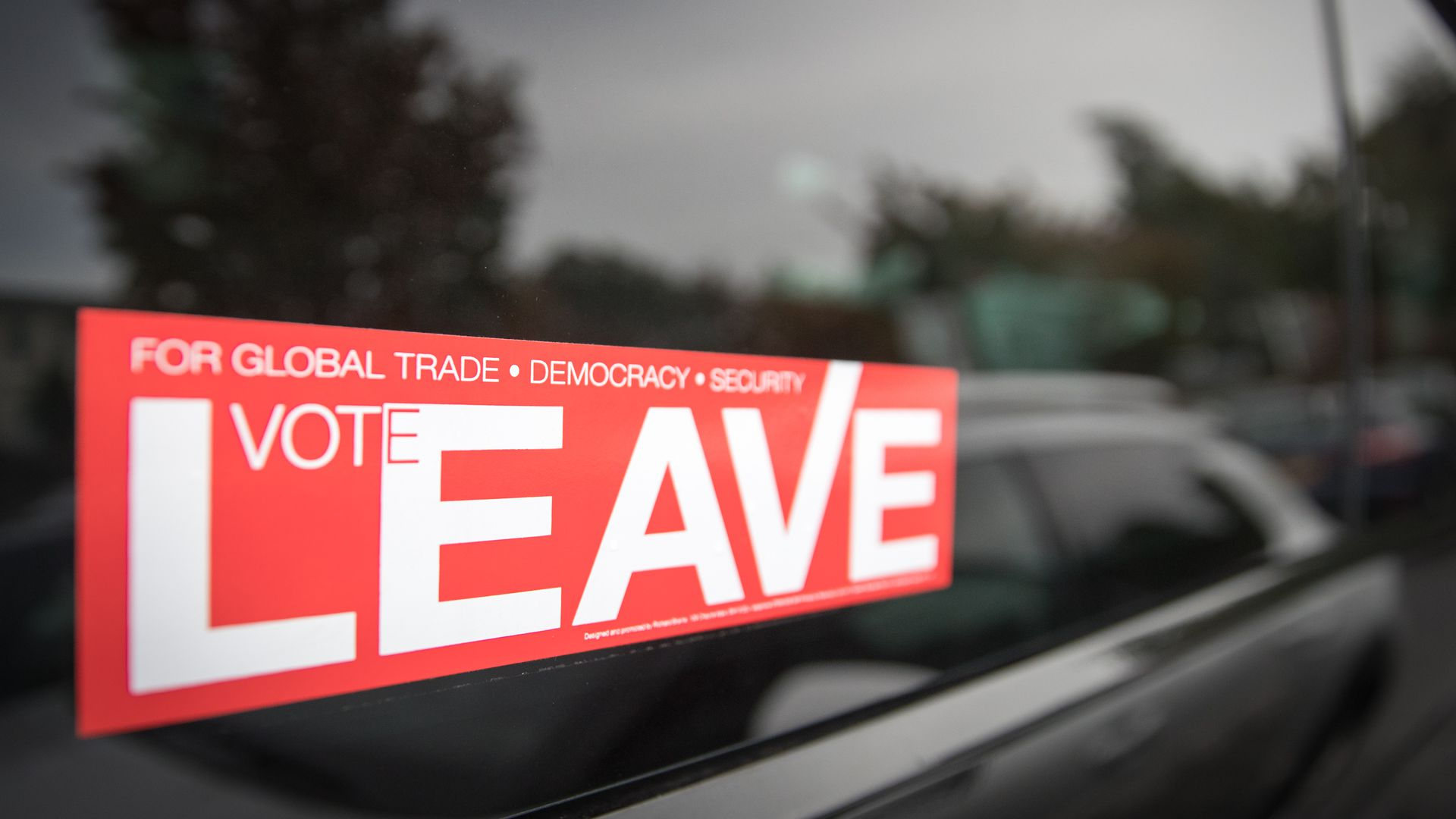 "A pro-Brexit sticker reads ""Vote Leave"""