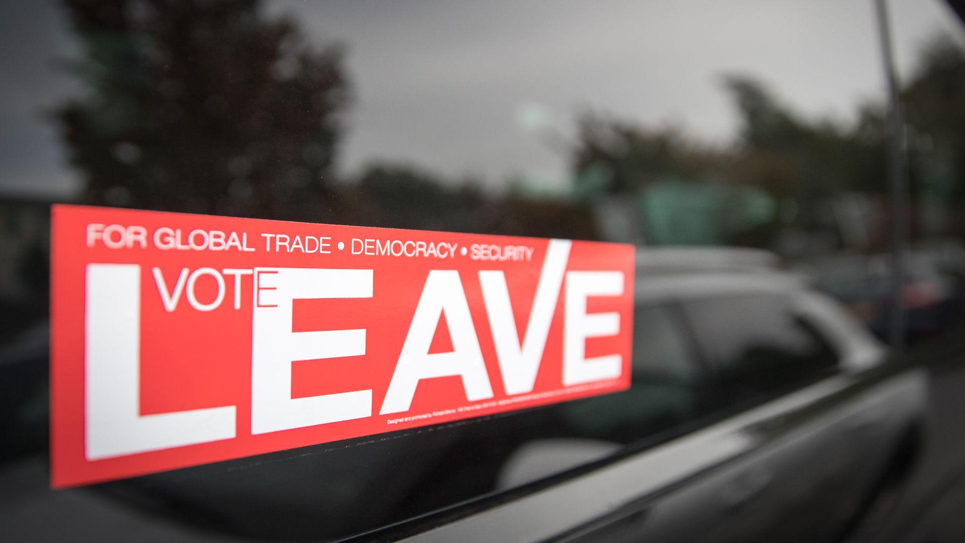 "A pro-Brexit sticker reads ""Vote Leave"""