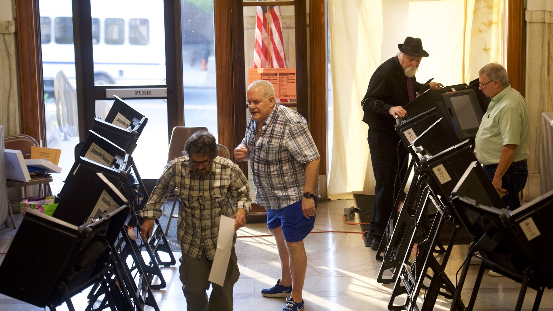 Election officials prepare voting booths in the 2018 Pennsylvania Primary Election