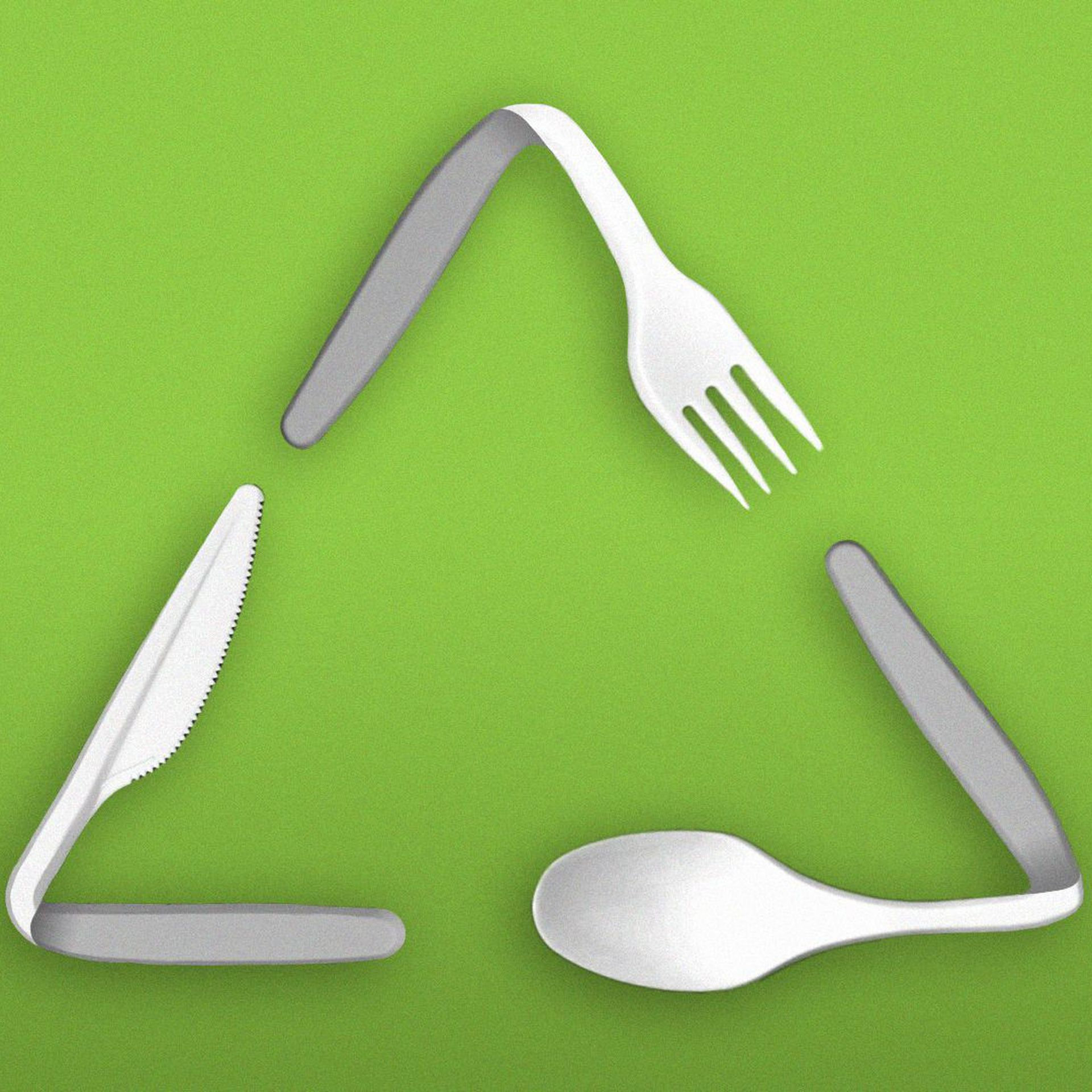 Recycling symbol made of plastic utensils