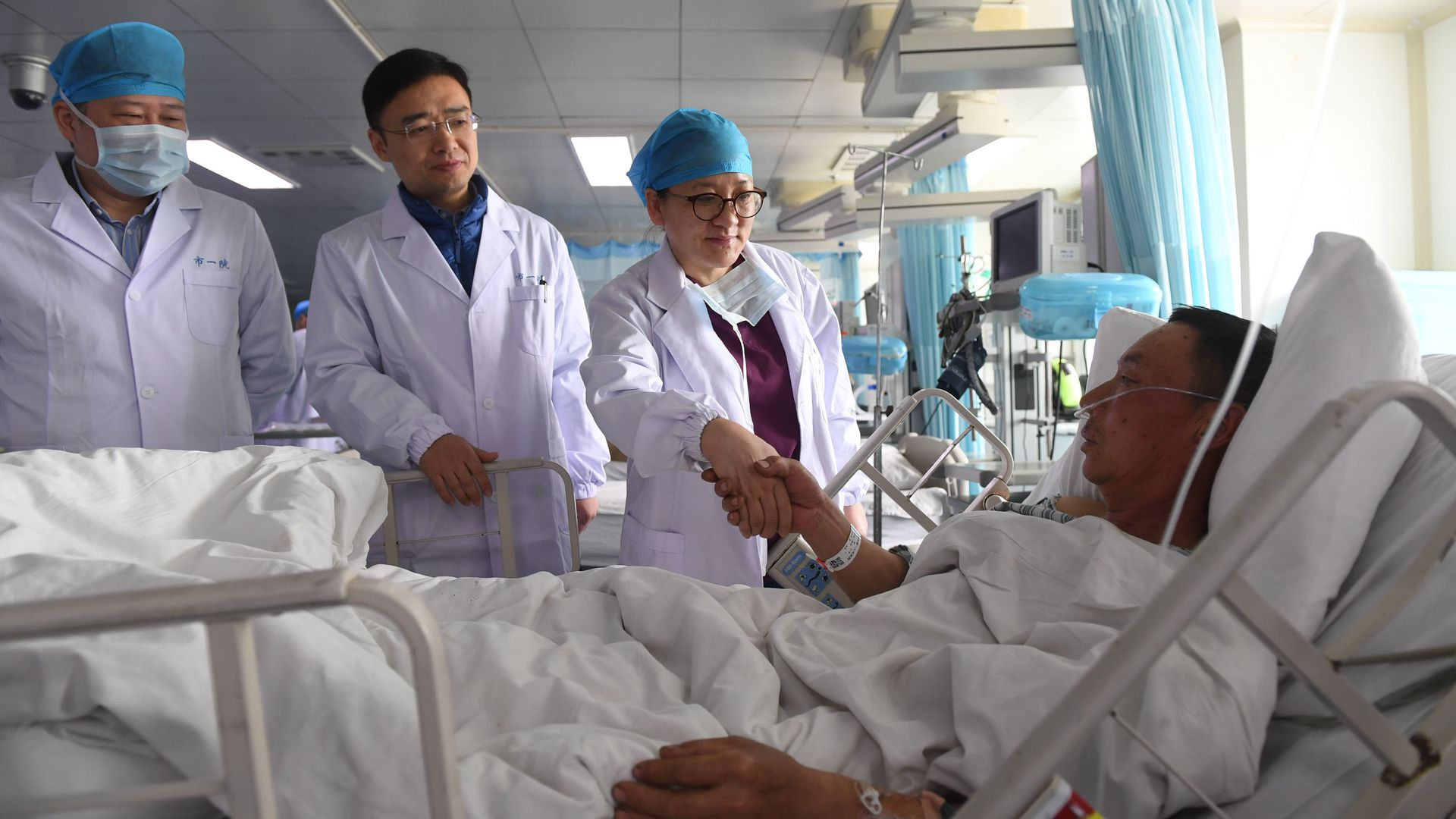 Doctors visiting a patient in a Chinese hospital