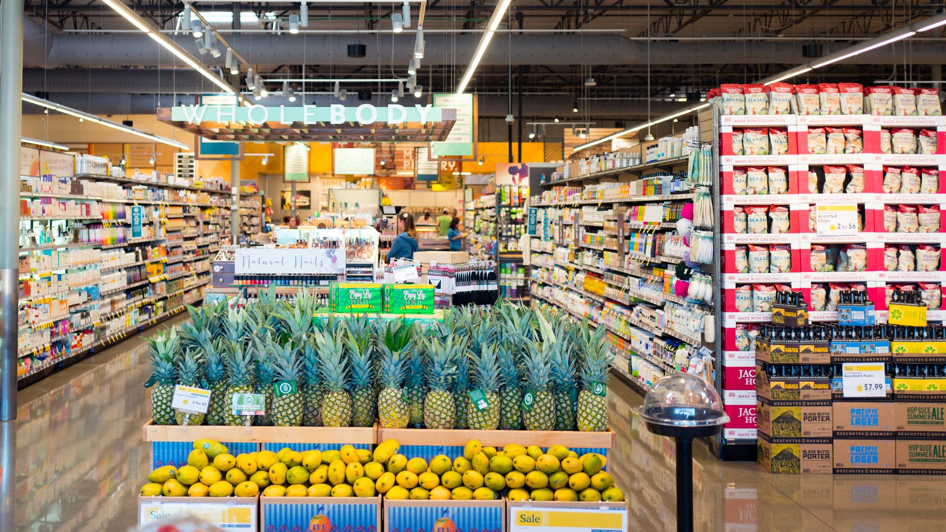 A headlong view of a Whole Foods aisle stocked with colorful boxes