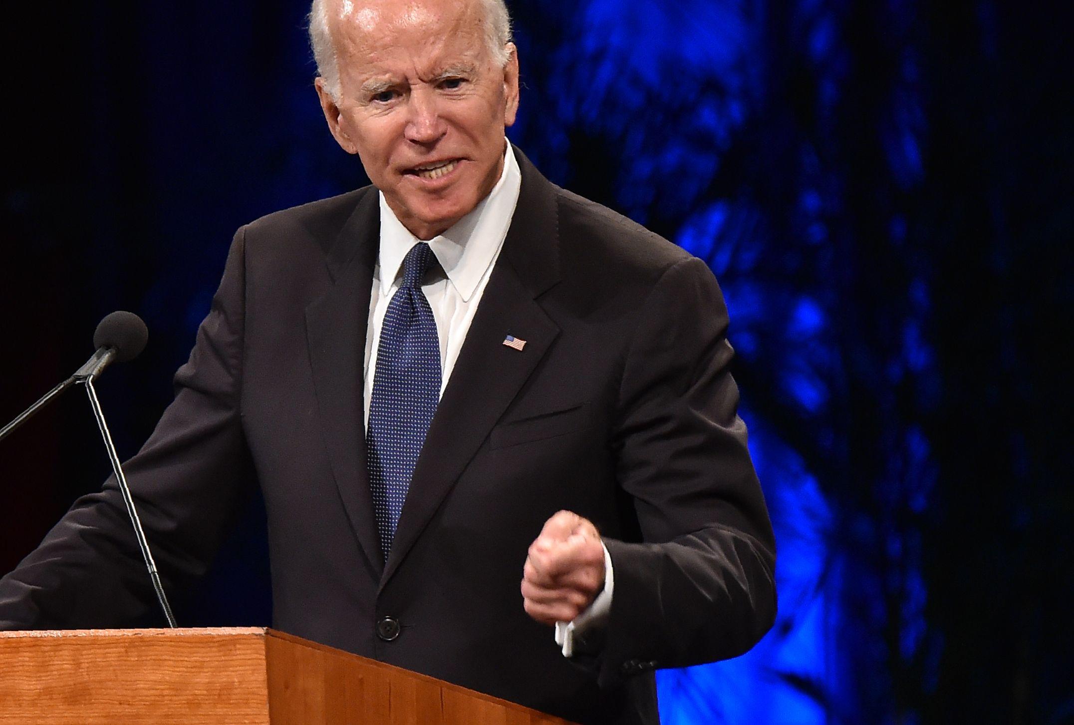 Joe Biden points and looks sad
