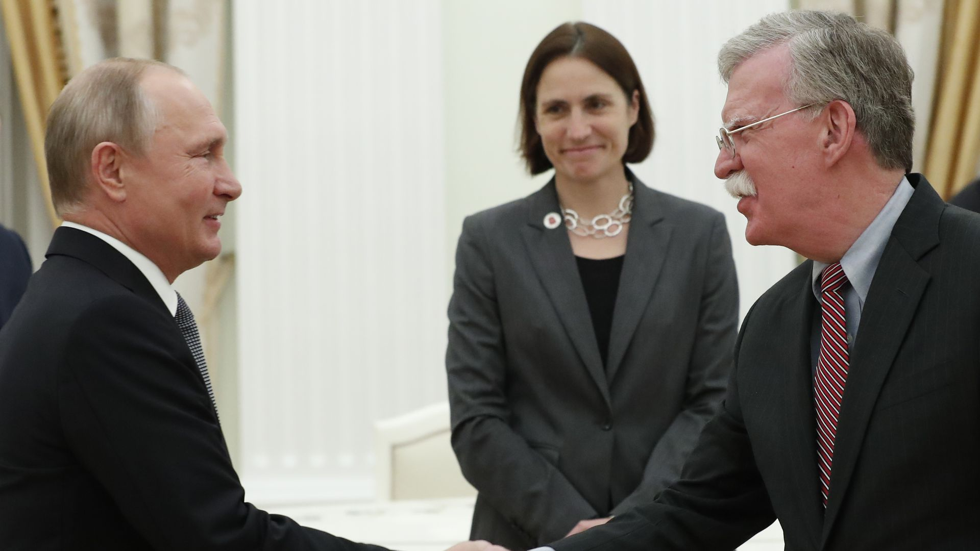 Russian President Vladimir Putin shakes hands with John Bolton, National Security Adviser to the US President, during a meeting at the Kremlin in Moscow on October 23, 2018.