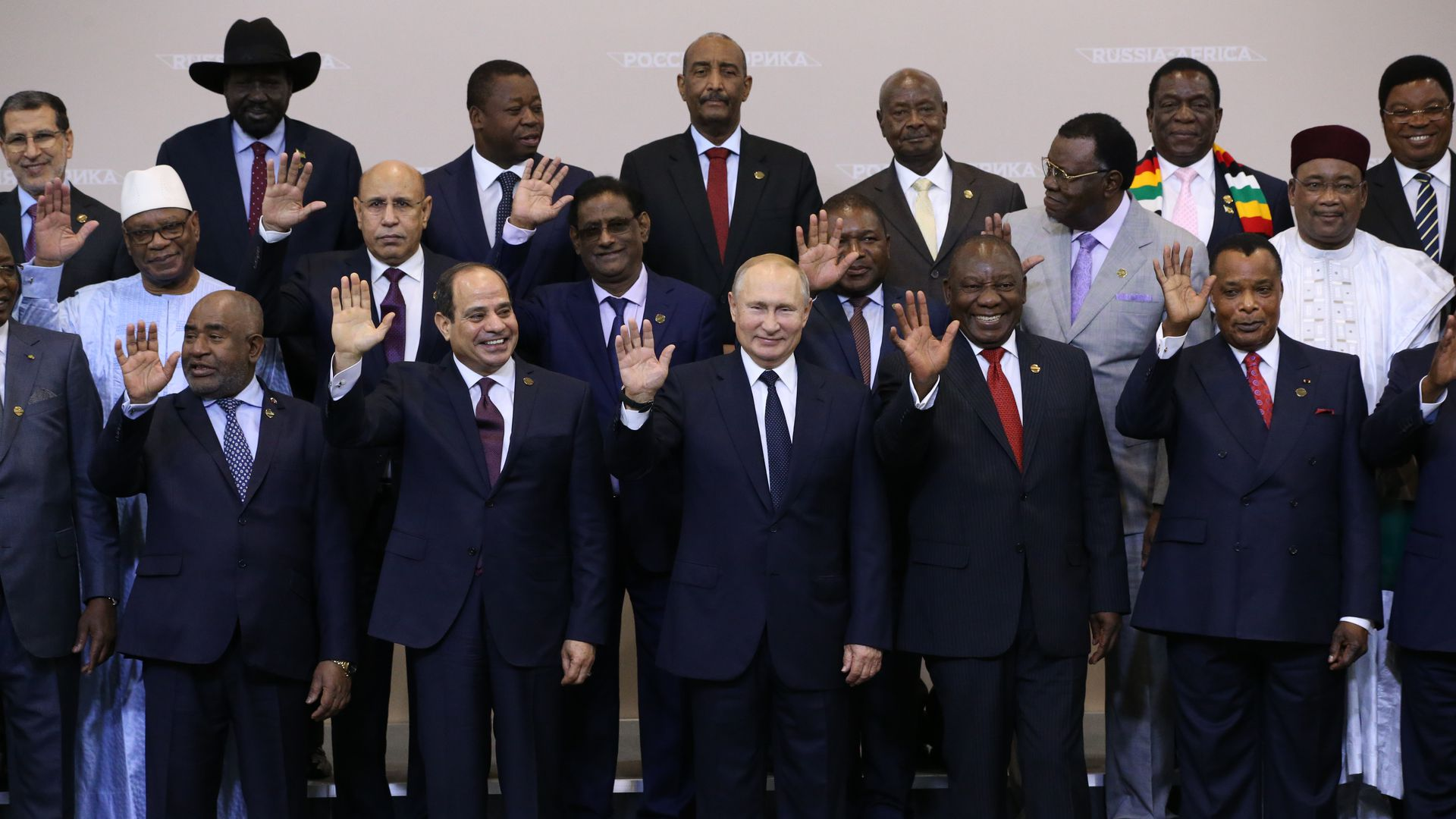 Putin and African leaders gathered and waving