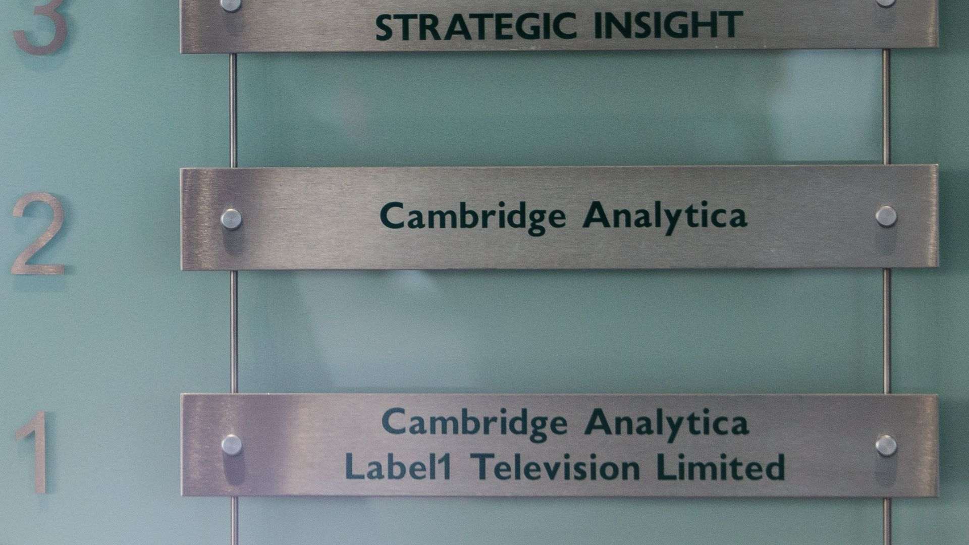 "A sign reading ""Cambridge Analytica"""
