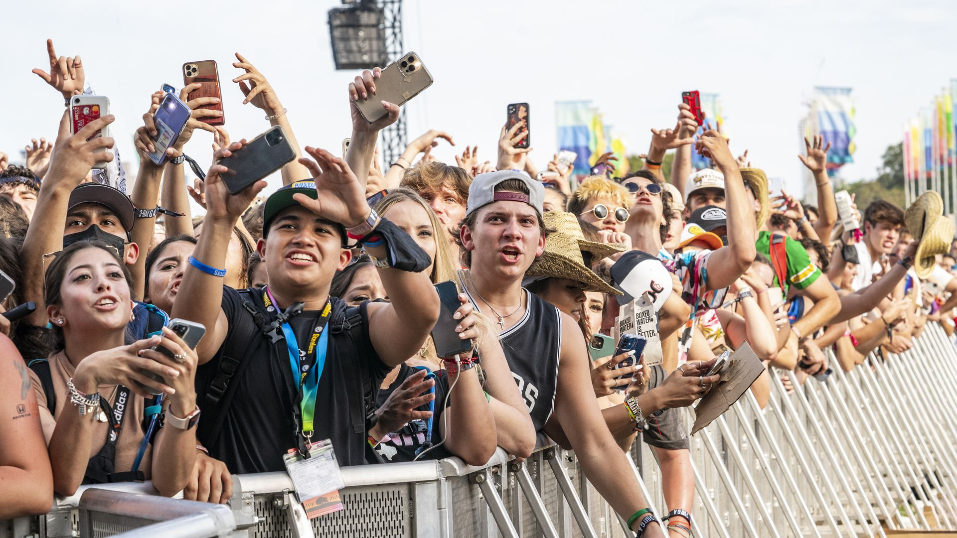 A crowd stands behind a barricade at Austin City Limits music festival
