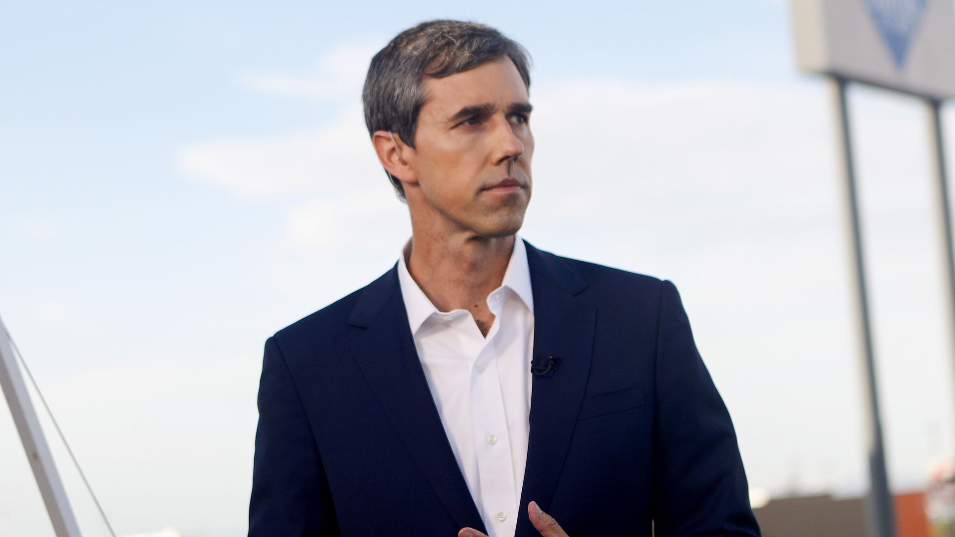 Beto standing and looking to the side.
