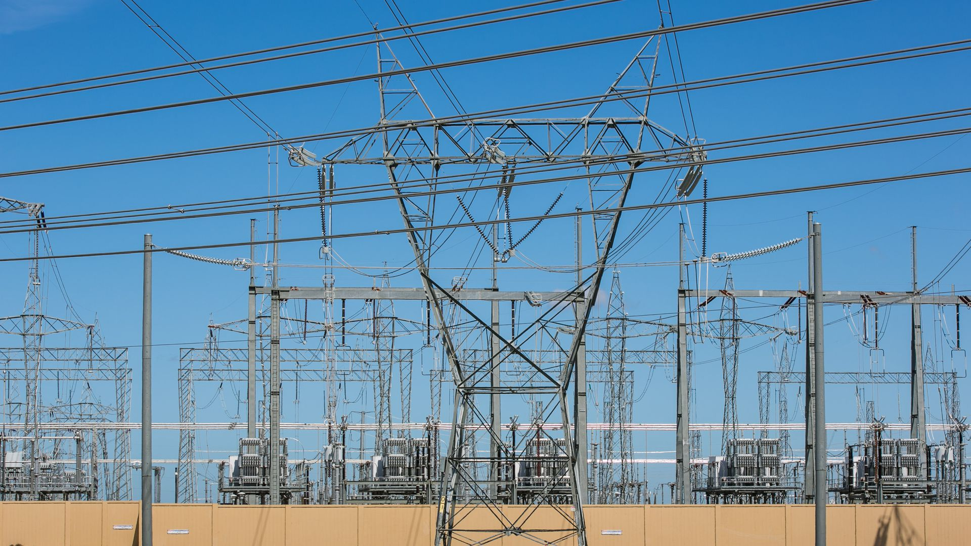 Poll Public Energy Fears At Two Decade Low Axios Overhead Transformer Wiring Diagram High Tension Electrical Power Lines A Transfer Station In California Photo George Rose Getty Images