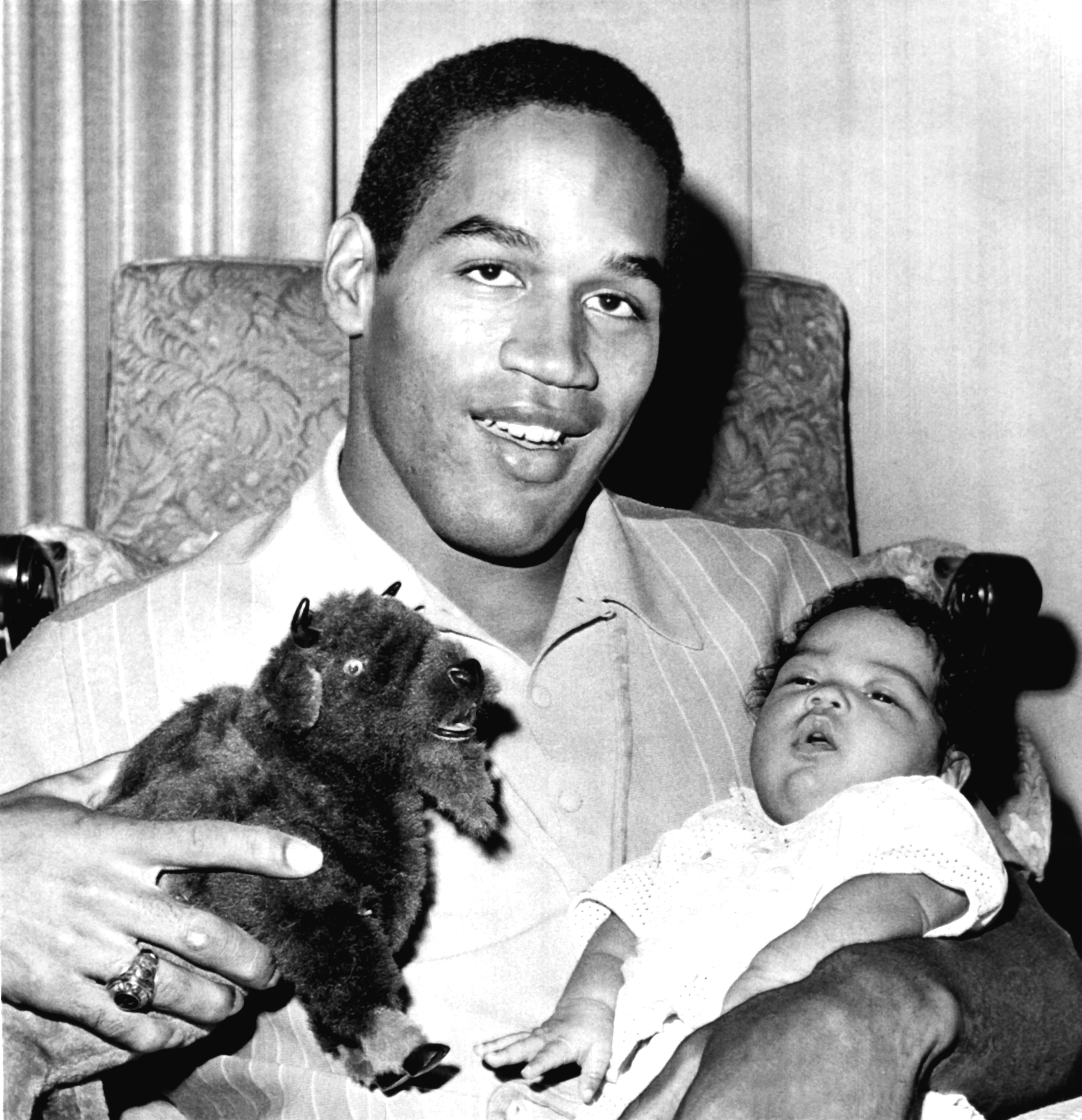 O.J. Simpson holding his daughter