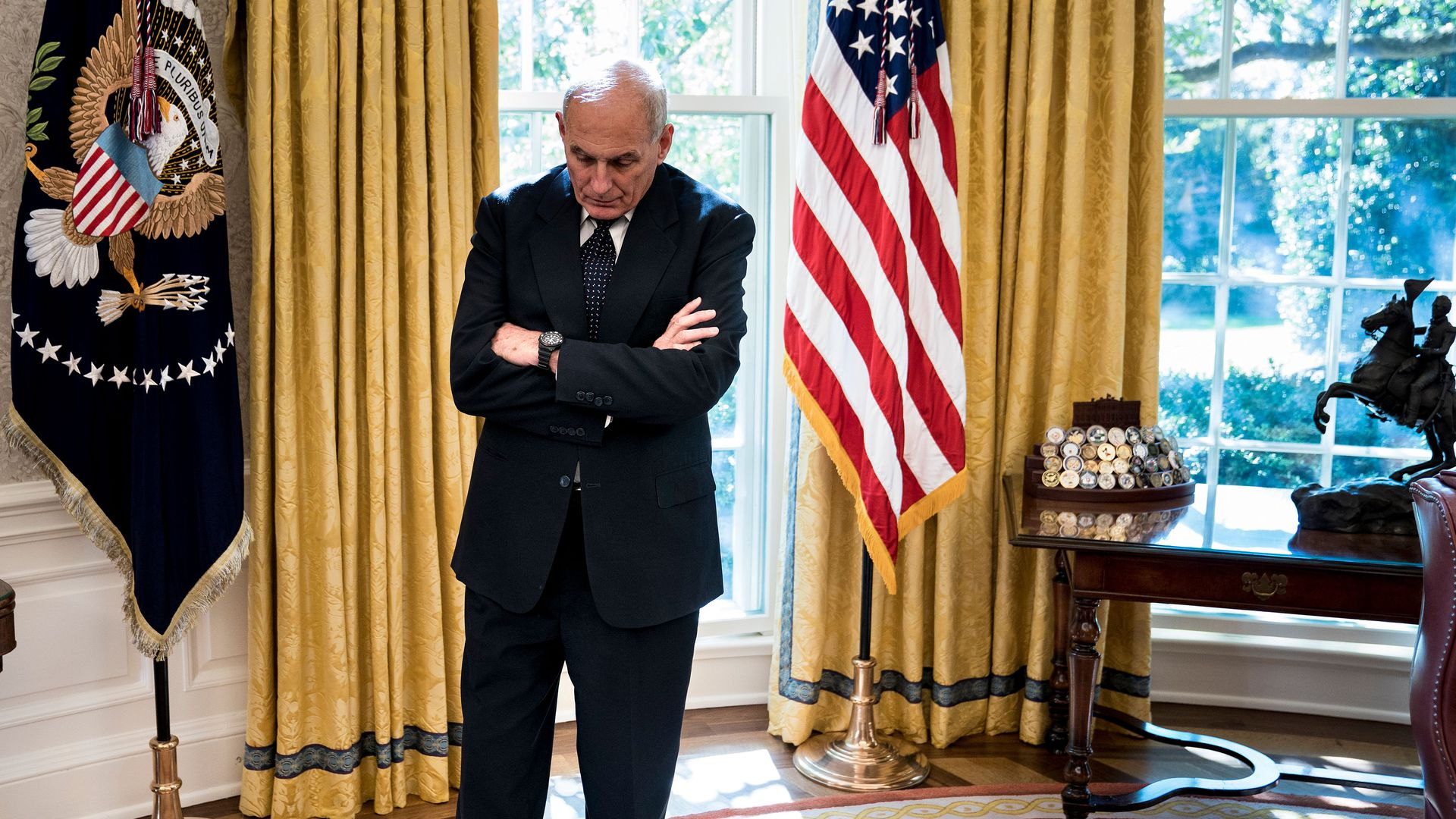 White House Chief of Staff John Kelly hangs his head while standing alone in the Oval Office of the White House