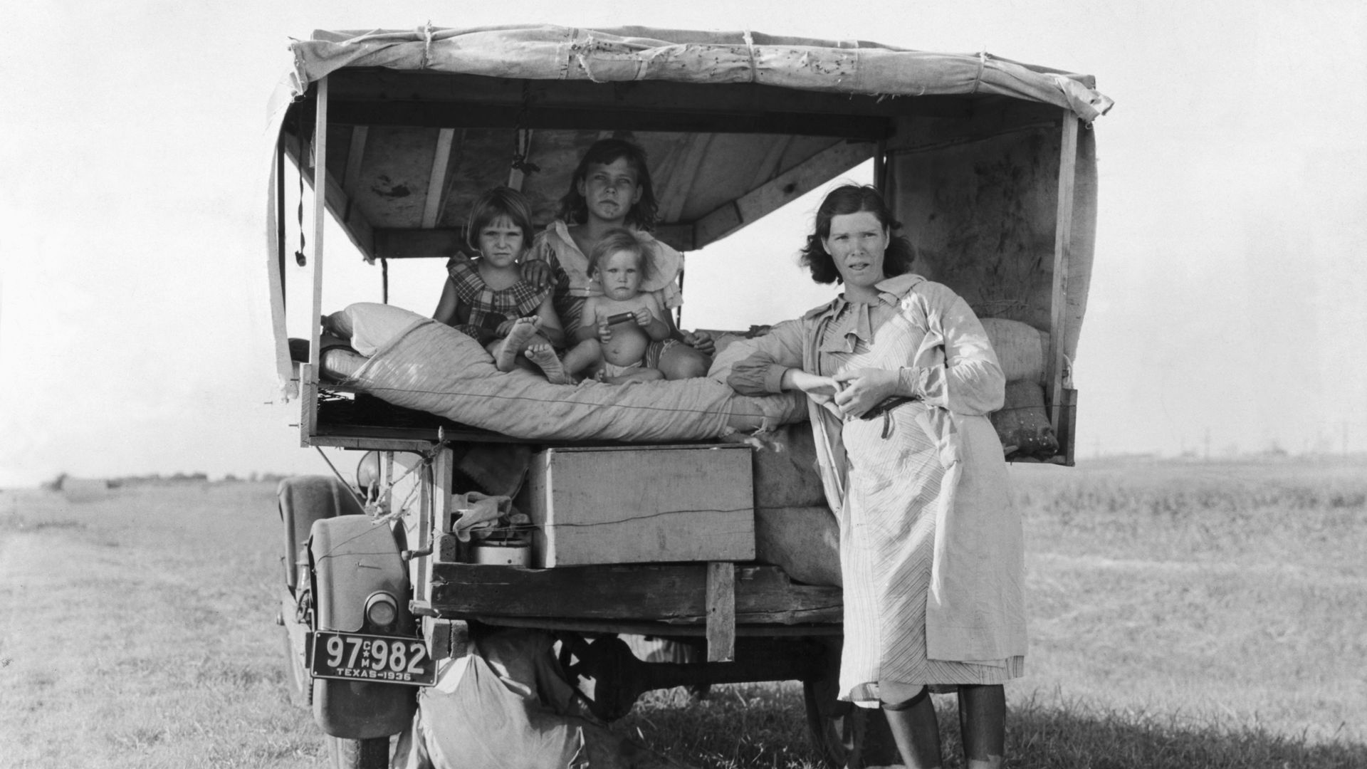 A black and white photo of a family in a carriage