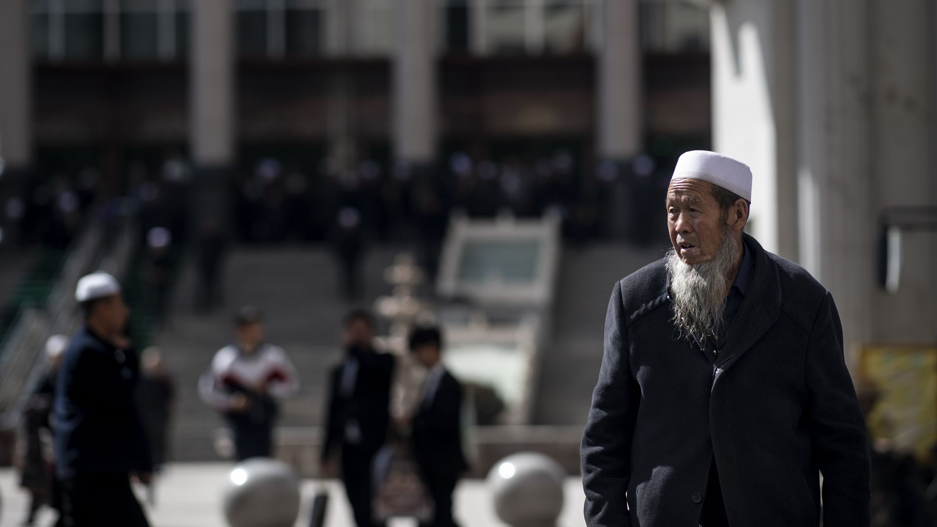 Ethnic Hui Muslim man standing in front of Laohuasi Mosque