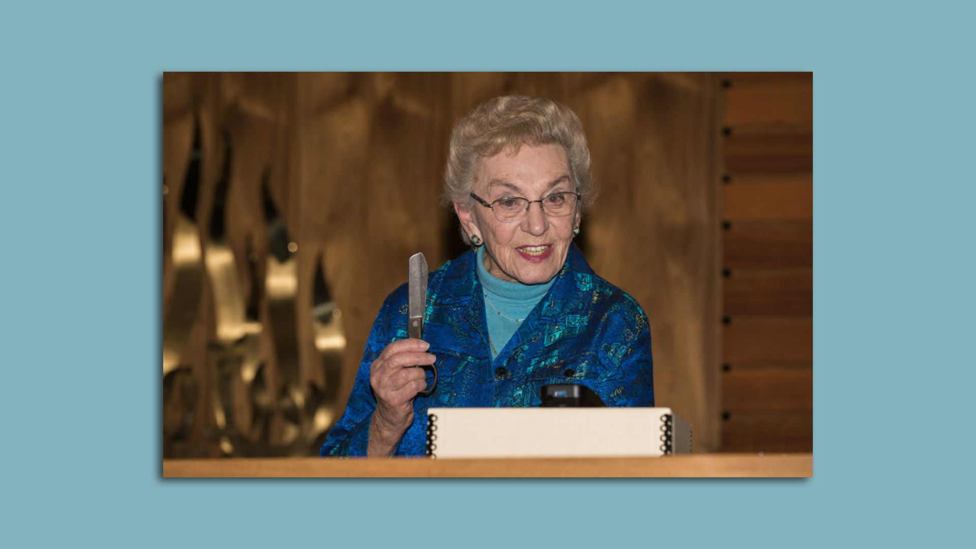 Celina Karp Biniaz holds a pair of scissors Oskar Schindler gave her family to barter for supplies after being liberated from his factory in 1945.