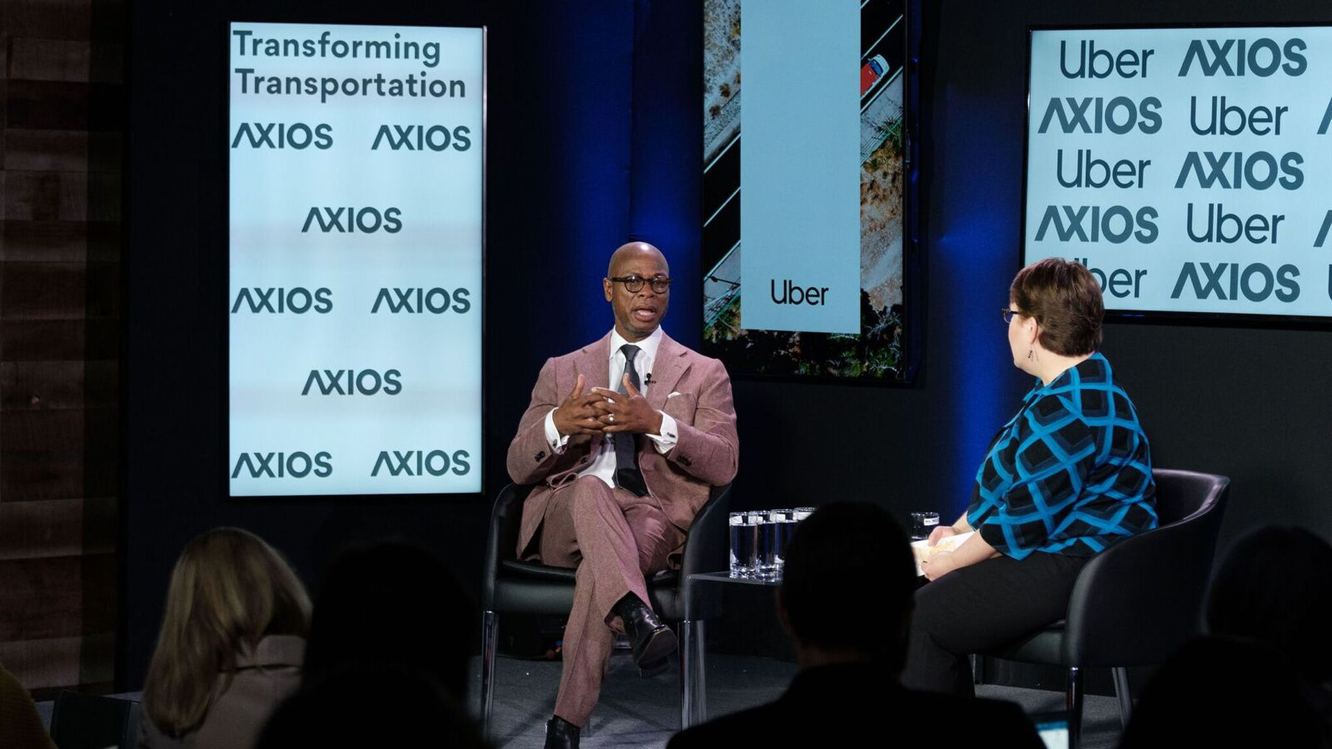 Clarence Anthony and Joann Muller on the Axios stage