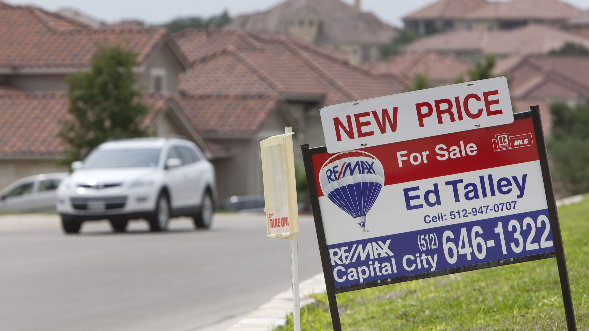 A for-sale sign outside an Austin area home.