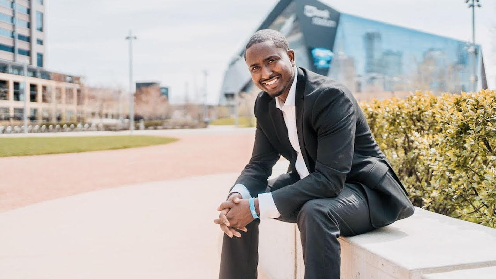 A photo of Minneapolis mayoral candidate AJ Awed smiling.