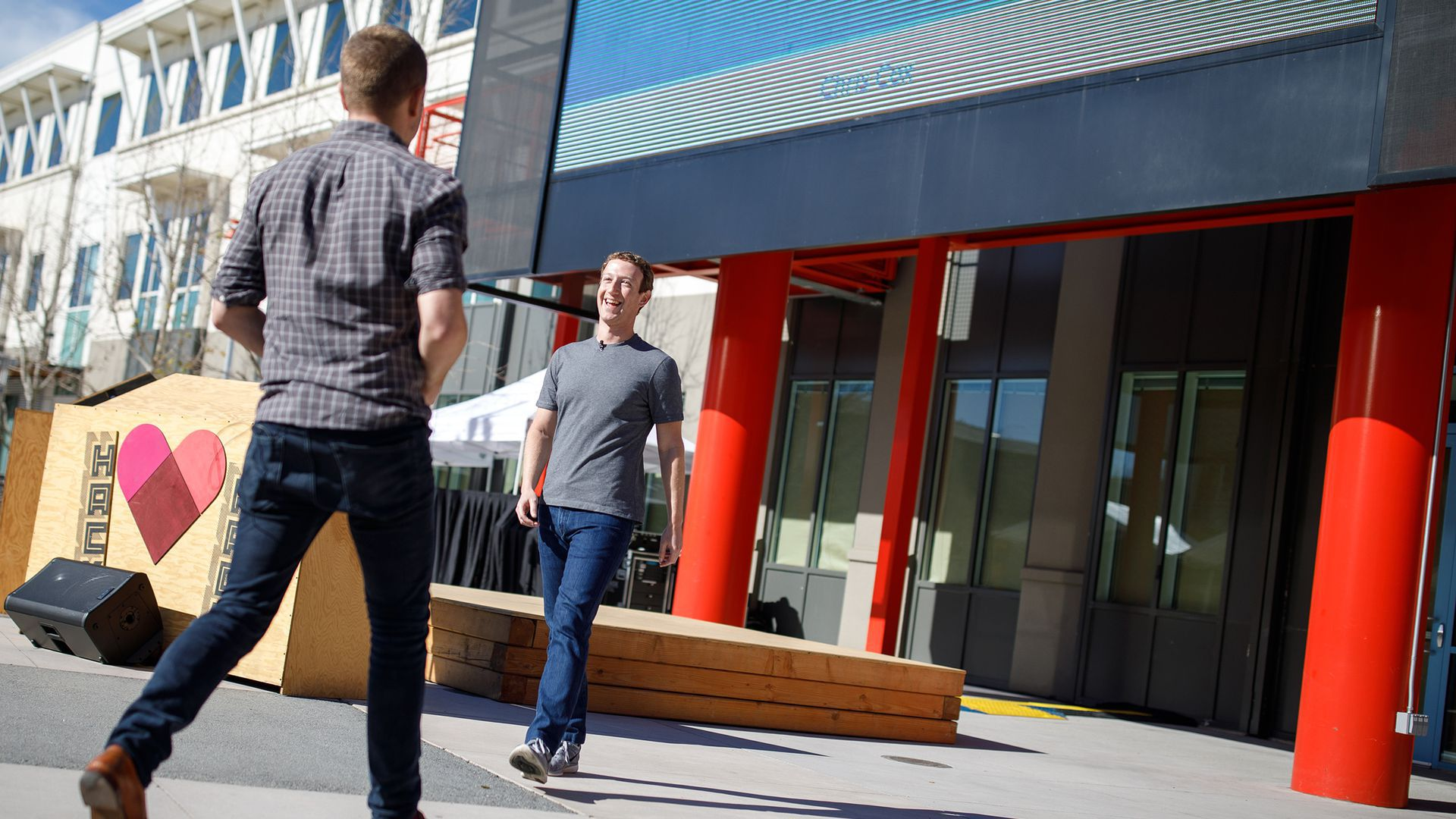 Chris Cox crosses paths with Mark Zuckerberg at a Facebook staff meeting.