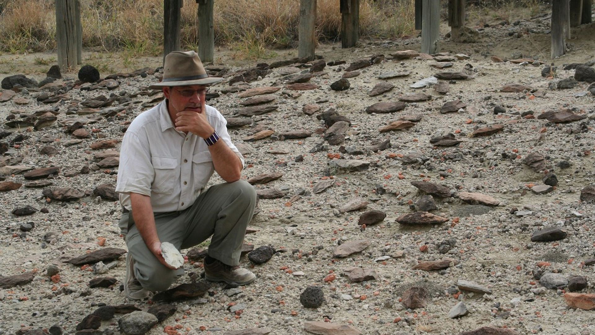 Rick Potts surveys assortment of Early Stone Age handaxes discovered in the Olorgesailie Basin, Kenya. Photo: Human Origins Program, Smithsonian