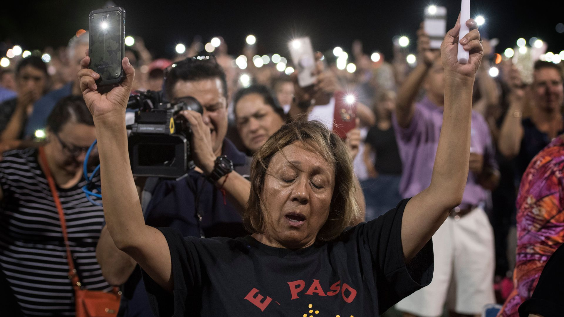 People react during a prayer vigil organized by the city.