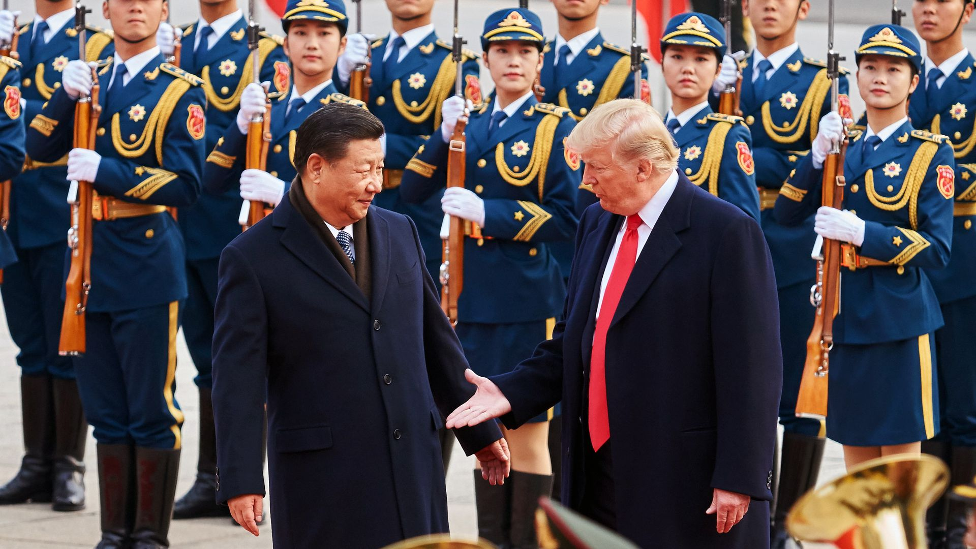 China's President Xi Jinping and US President Donald Trump (L-R front) shake hands during a meeting outside the Great Hall of the People in Beijing.