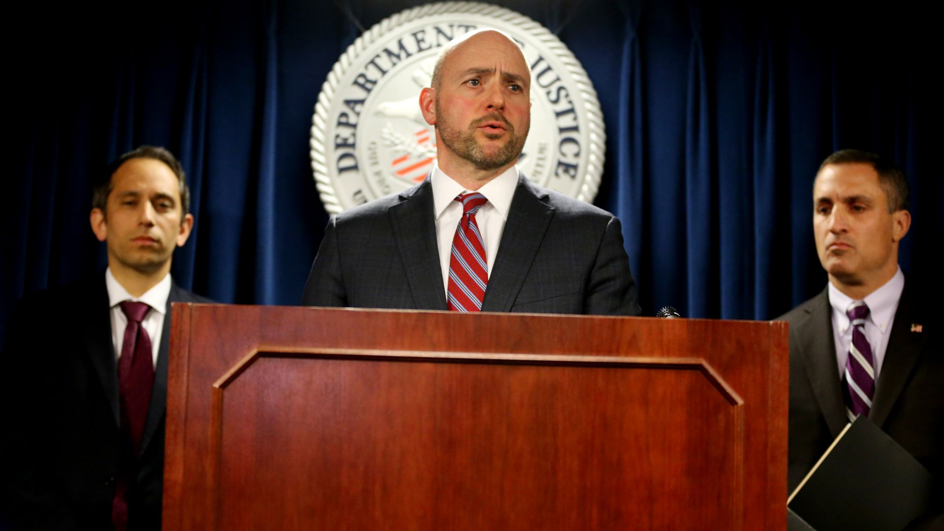 U.S. Attorney Andrew E. Lelling announcing charges against dozens of individuals involved in a nationwide college admissions cheating and recruitment scheme.