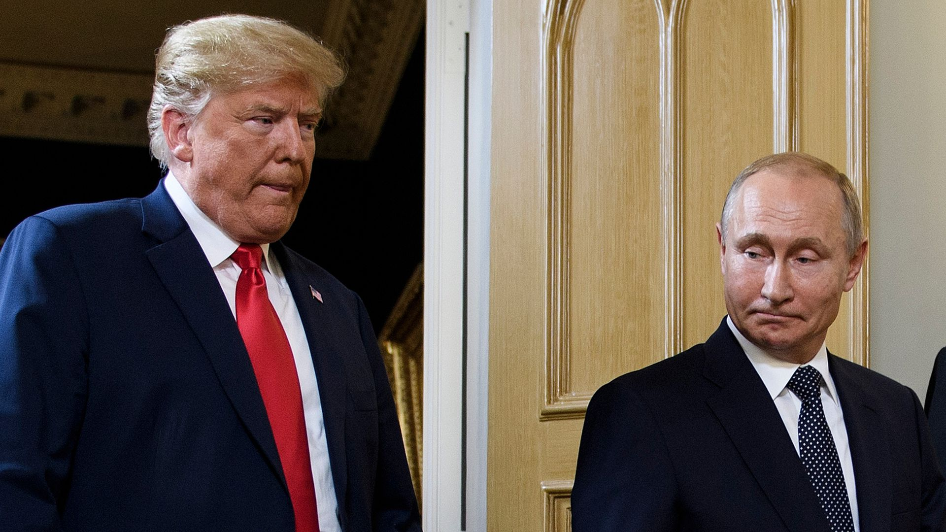 Trump and Putin standing next to each other