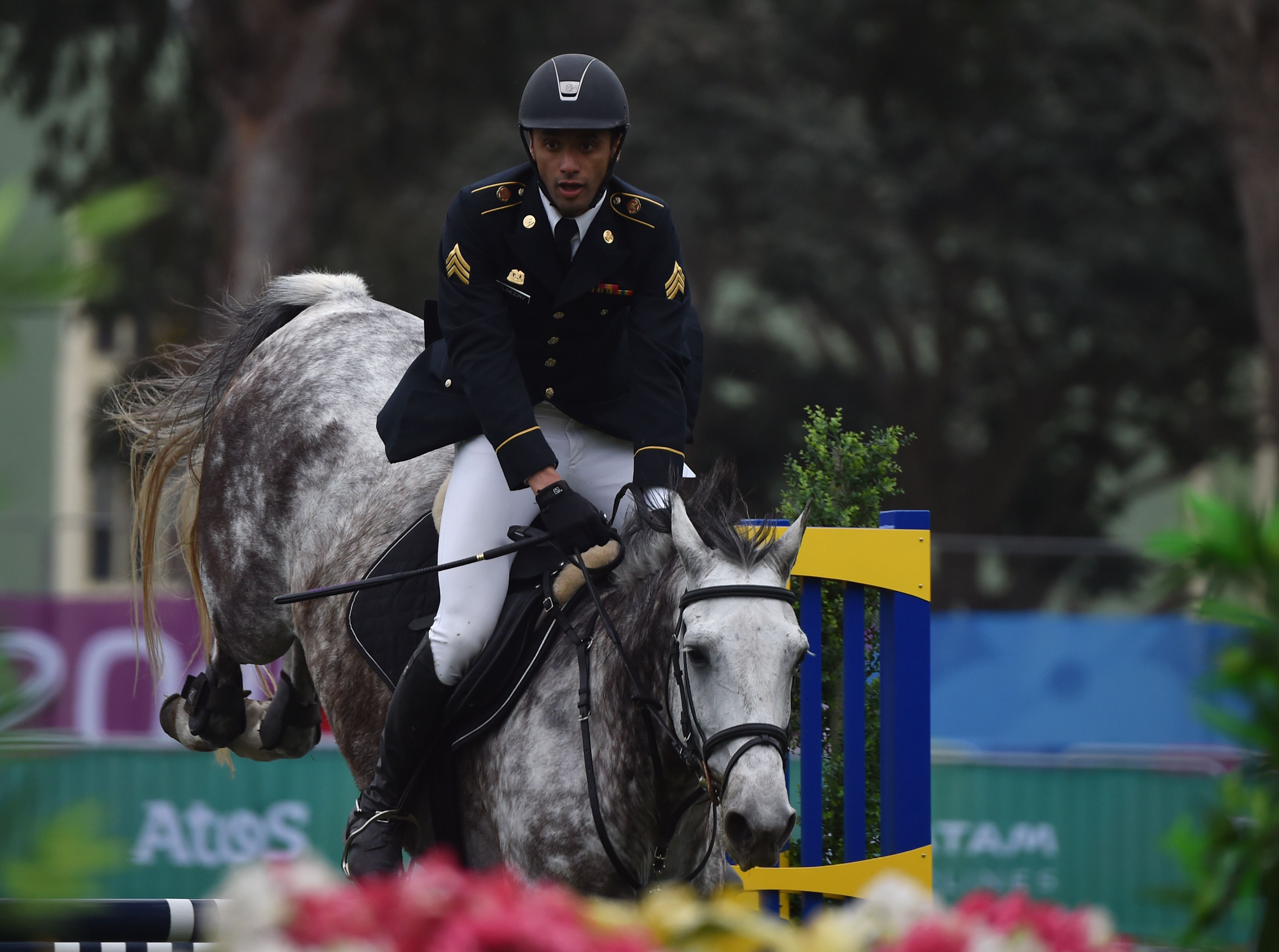 Amro ElGeziry rides a horse during the show jumping event at the Pan American Games in 2019.