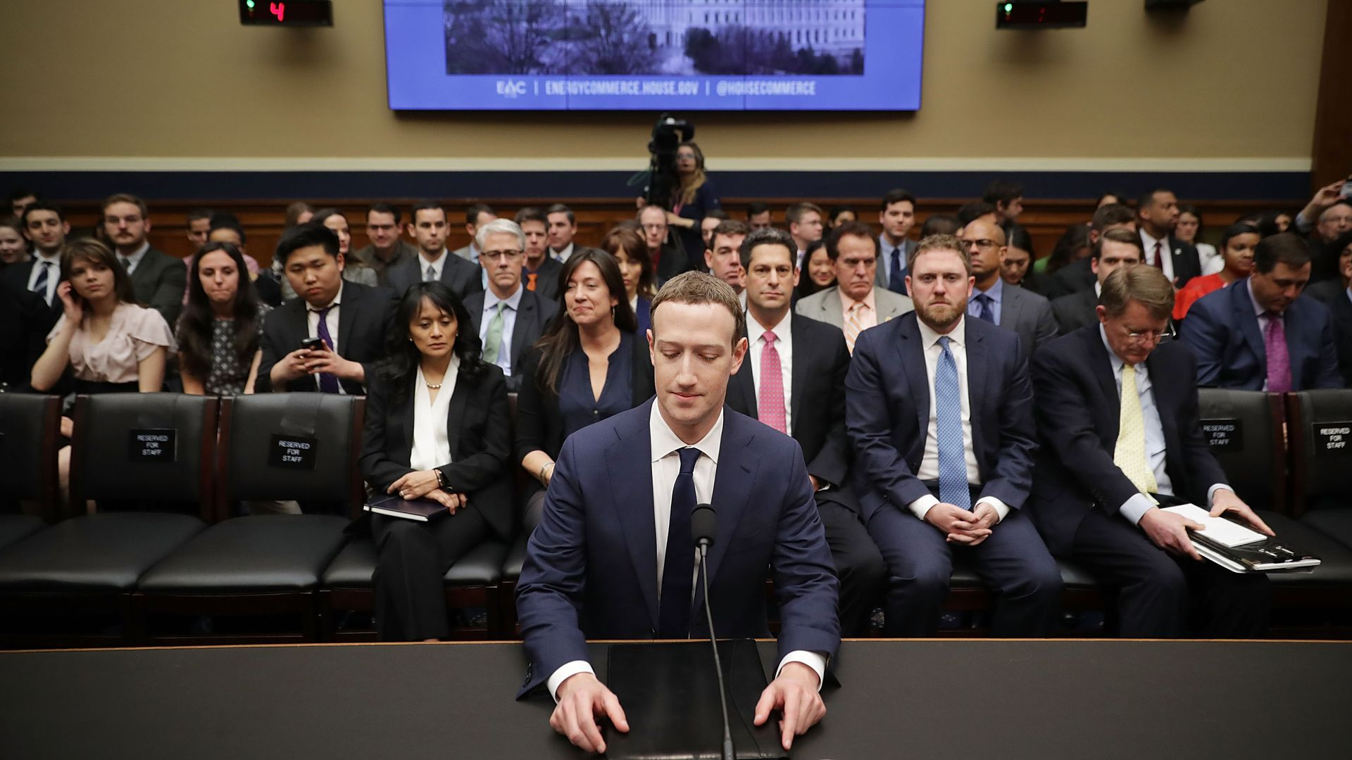 Mark Zuckerberg sits in front of spectators at one of his congressional hearings