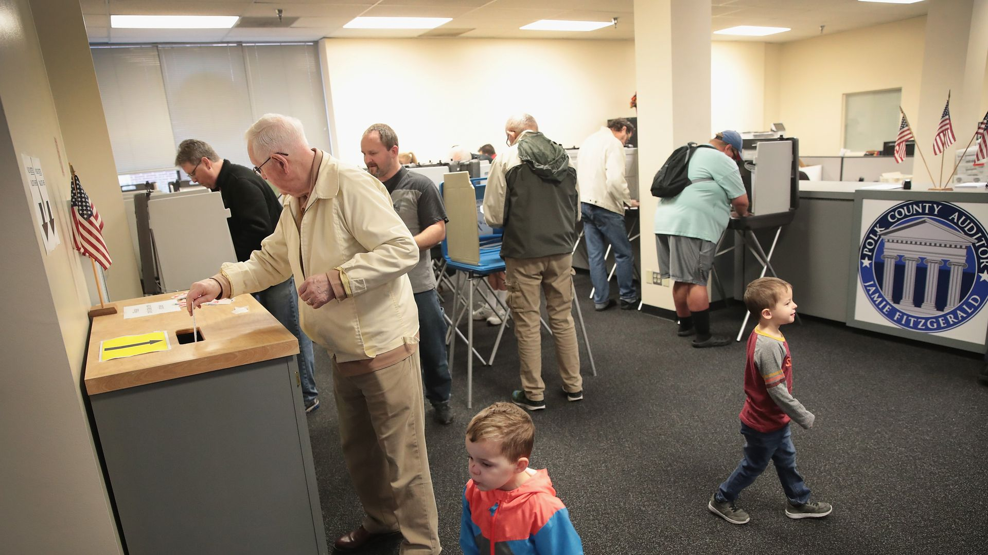 Citizens voting in Iowa
