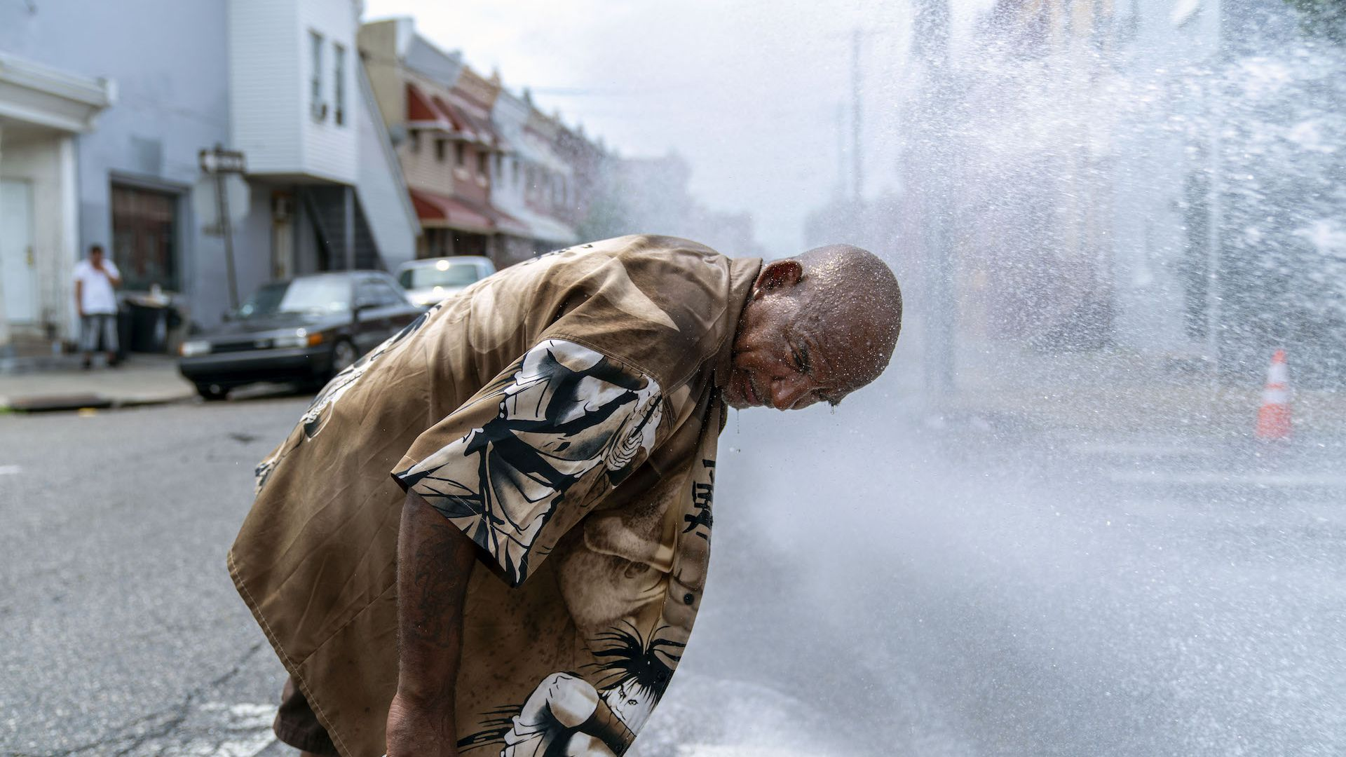 Eduardo Velev cools off in the spray of a fire hydrant during a heatwave on July 1, 2018 in Philadelphia.