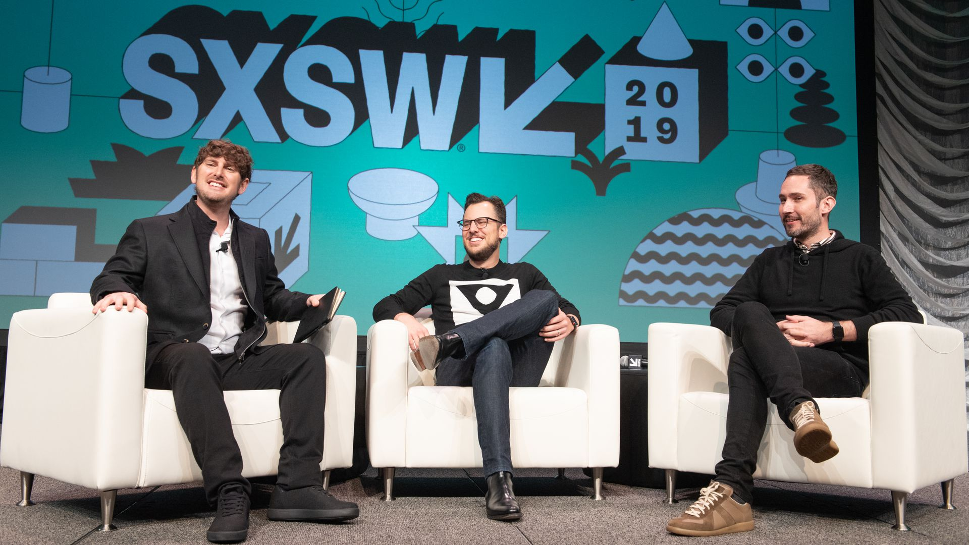Tech Crunch editor-at-large Josh Constine (L) interviews Instagram co-founders Mike Krieger (C) and Kevin Systrom live on stage during the 2019 SXSW Conference