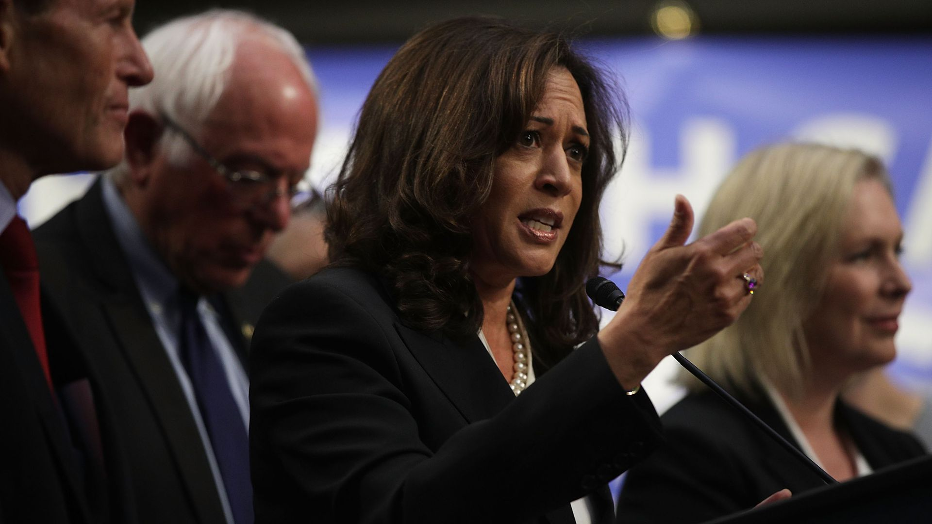 Kamala HArris at podium for medicare for all bill