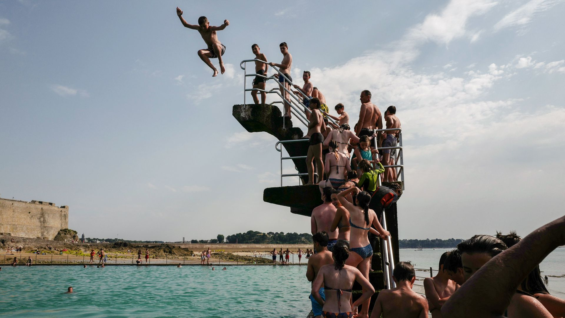 People queue to dive into the landmark sea pool of Saint-Malo, Brittany.