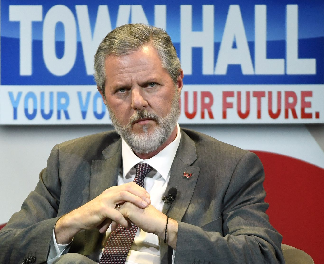 "Liberty University's Jerry Falwell Jr. agrees to ""indefinite leave of absence"""