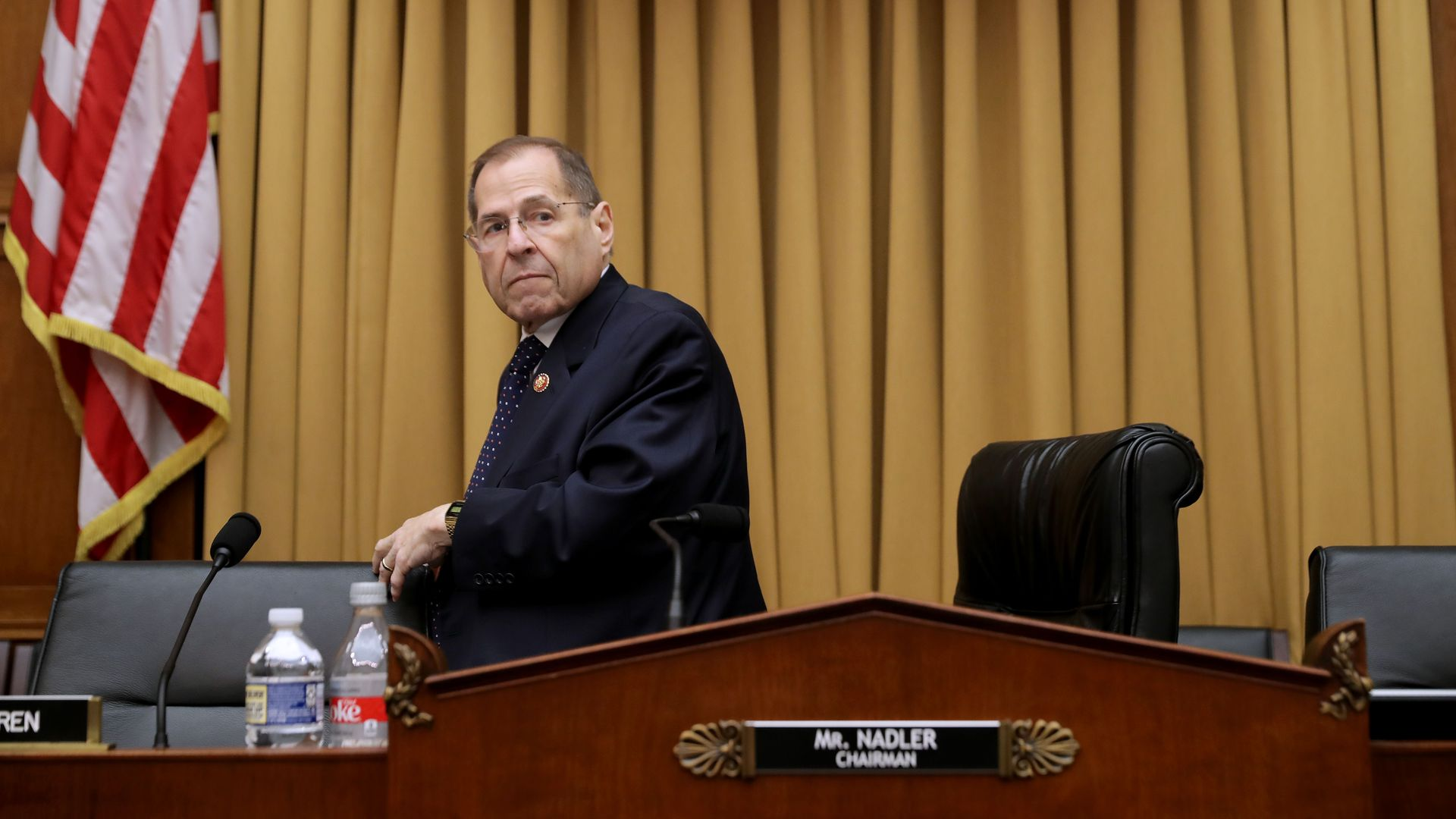 In this image, Nadler stands from his seat.