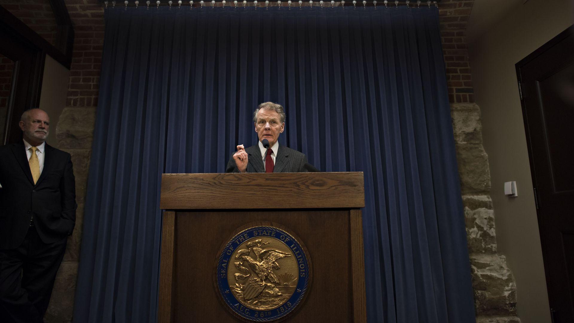 Politician at a podium.