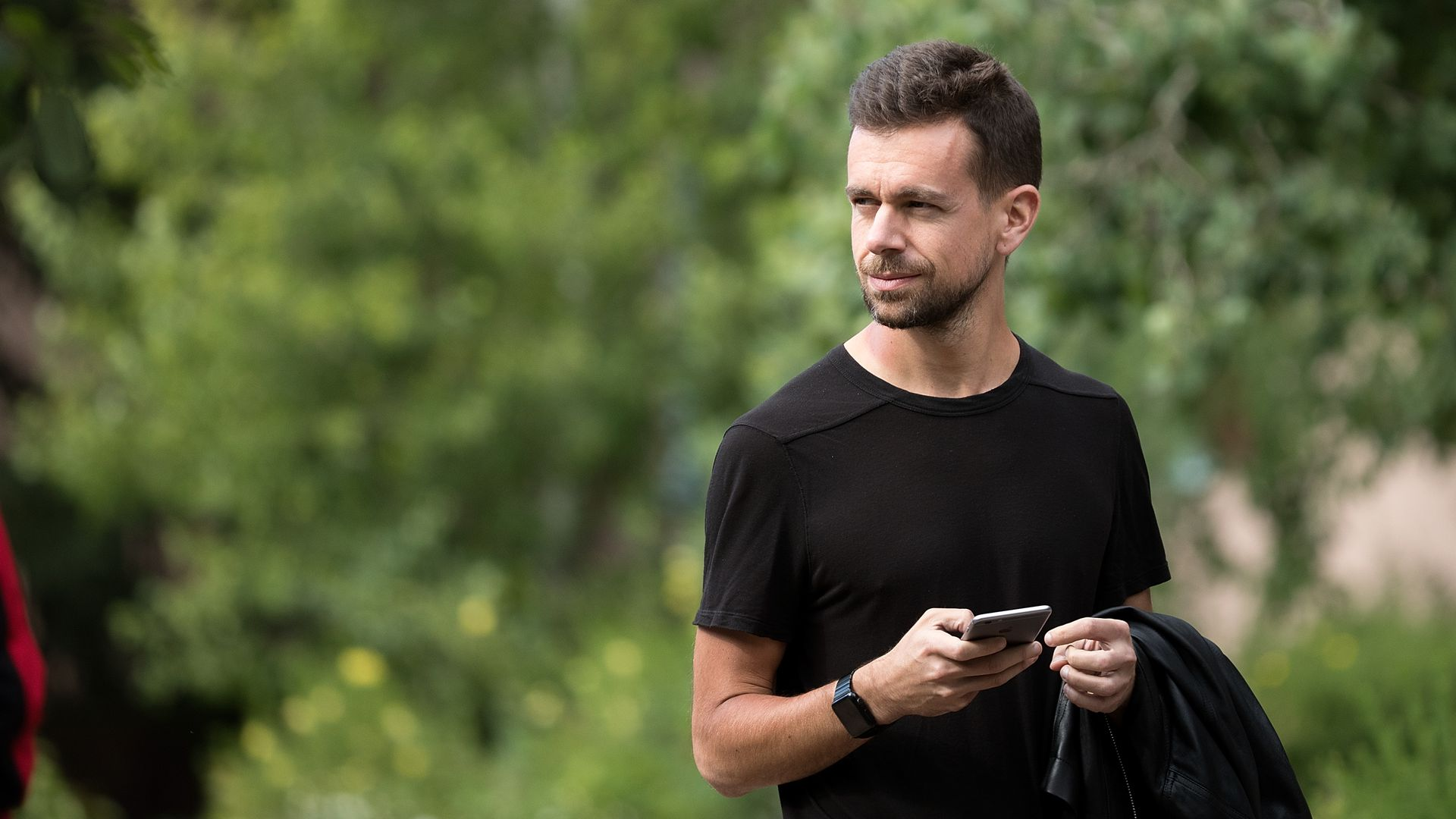 Jack Dorsey looking up from his phone.