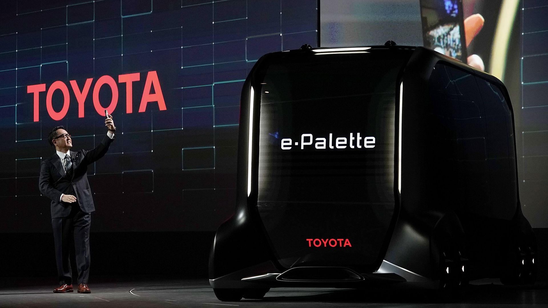 President of Toyota Motor Corporation and the e-Palette Concept Vehicle.