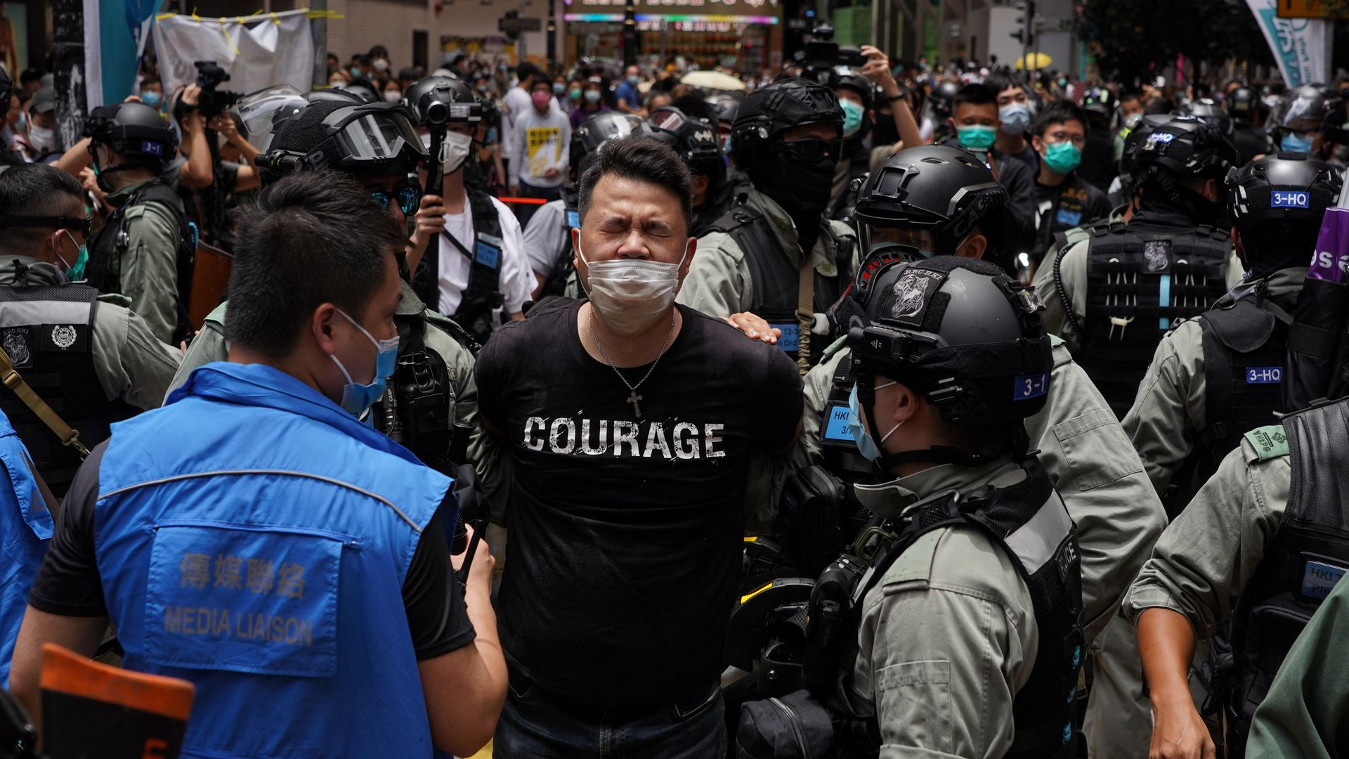 A pro-democracy lawmaker in Hong Kong is arrested by police during a protest