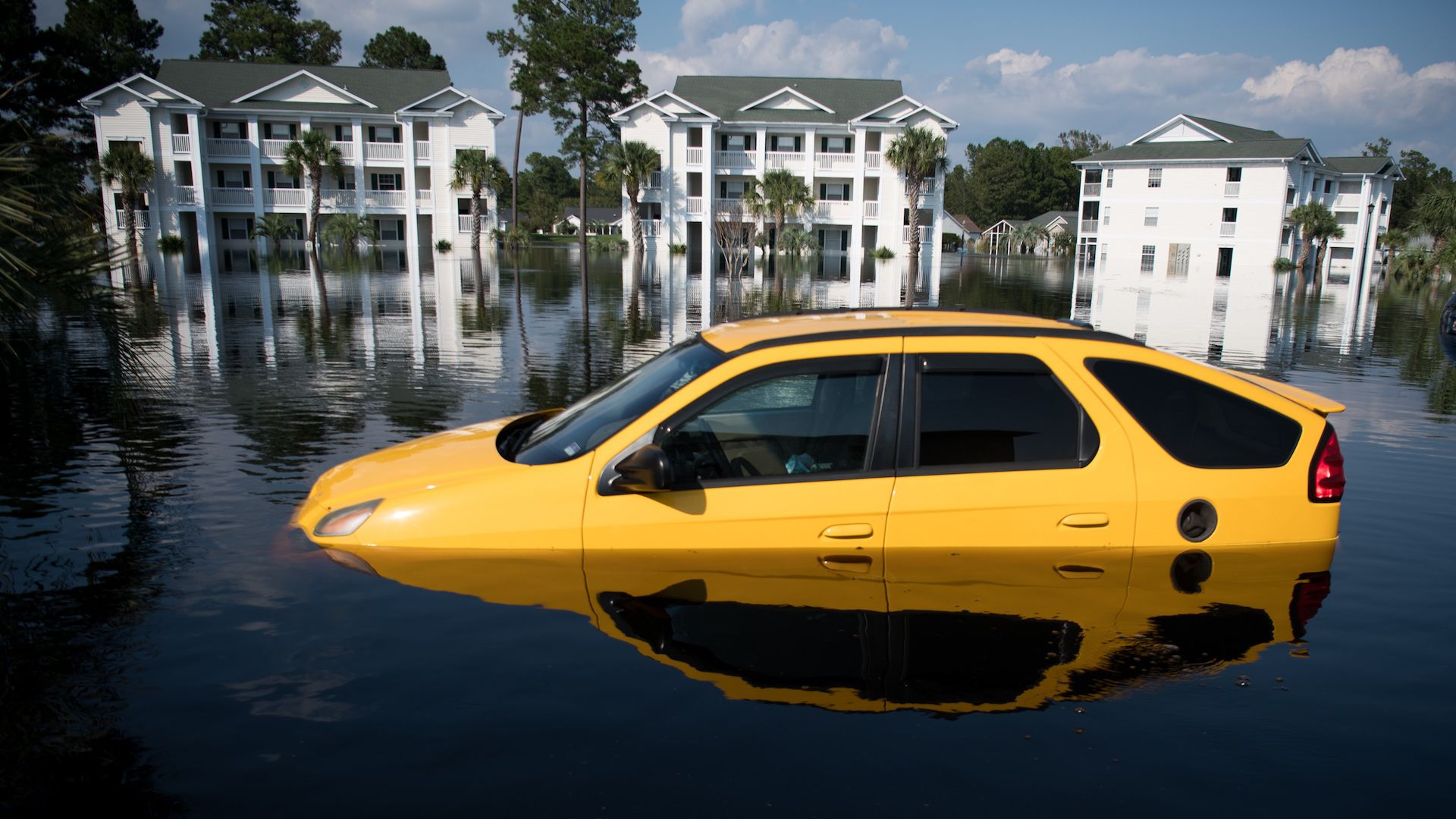 A car is inundated with floodwaters caused by Hurricane Florence at an apartment complex at Aberdeen Country Club on September 20, 2018 in Longs, South Carolina.