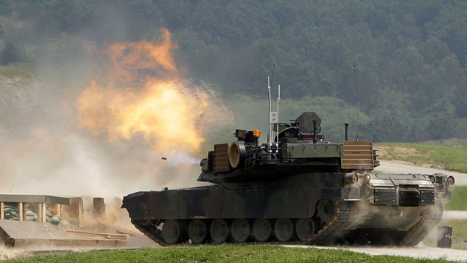 A U.S. M1A2 SEP Abrams battle tank fires live rounds during the United States and South Korean Joint live fire Exercise at Rodriguez Range on September 1, 2011.