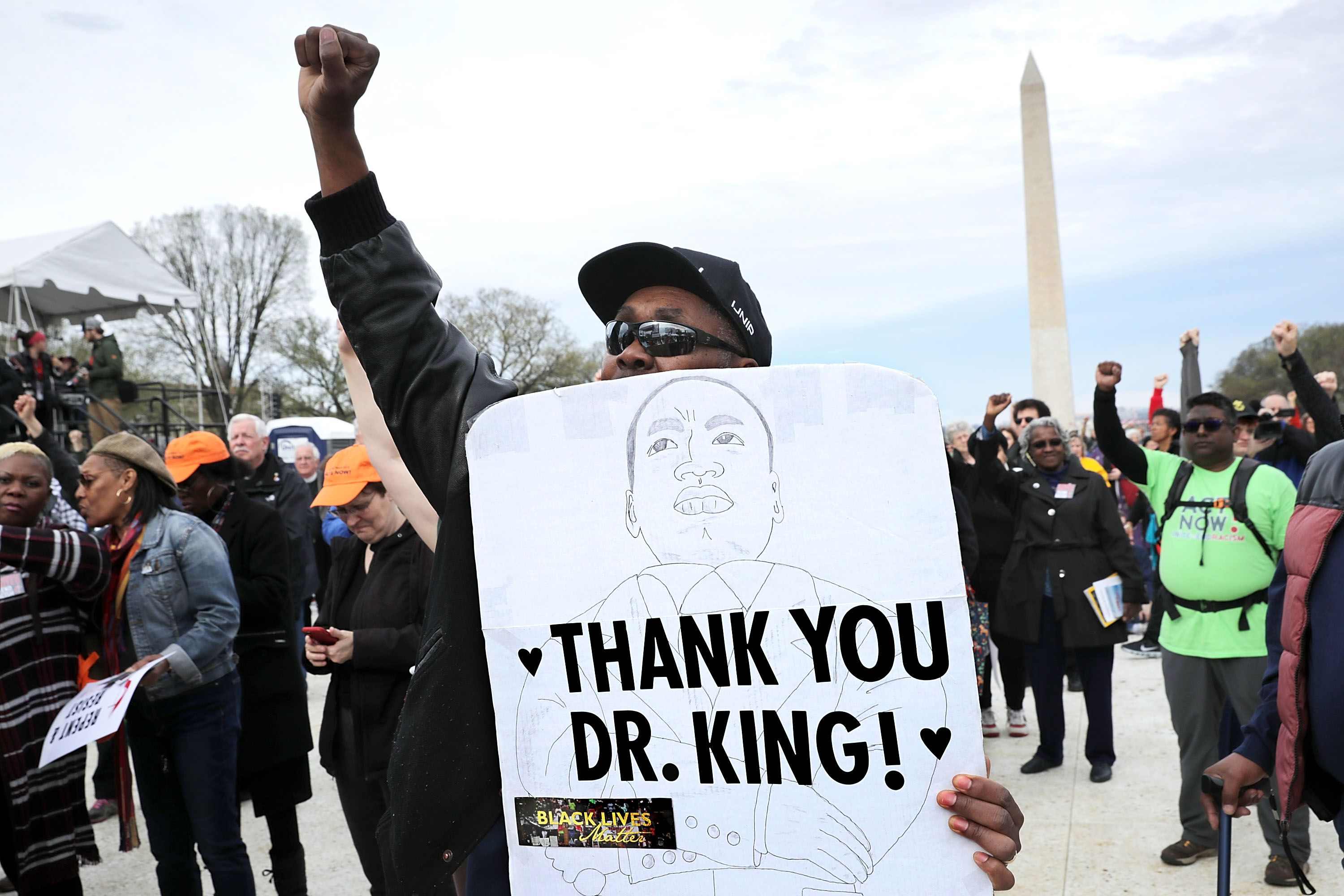 Thousands gather on the National Mall for a prayer rally to mark the 50th anniversary of Dr. Martin Luther King Jr.'s assassination