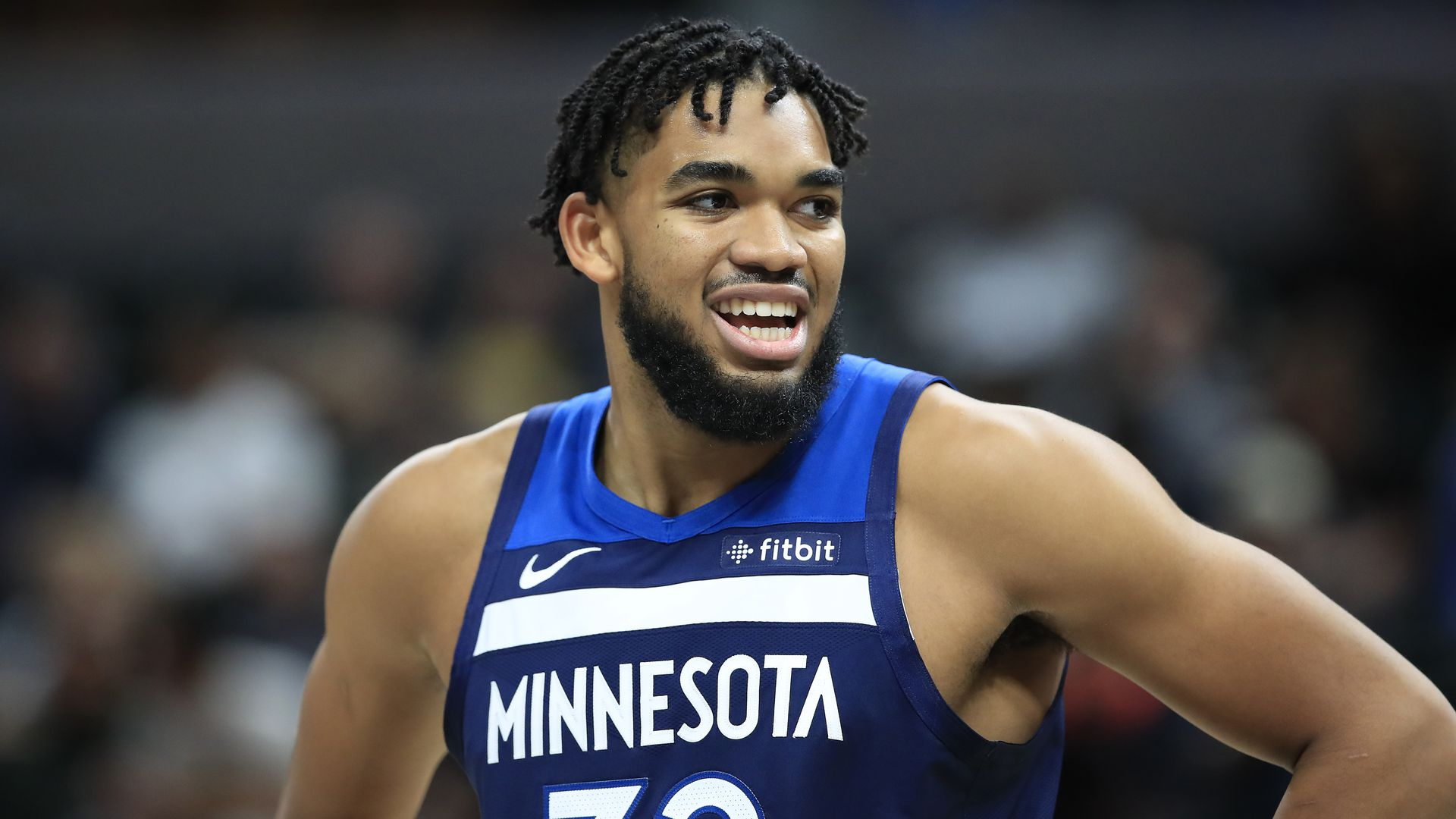 Karl Anthony Towns smiles during a game
