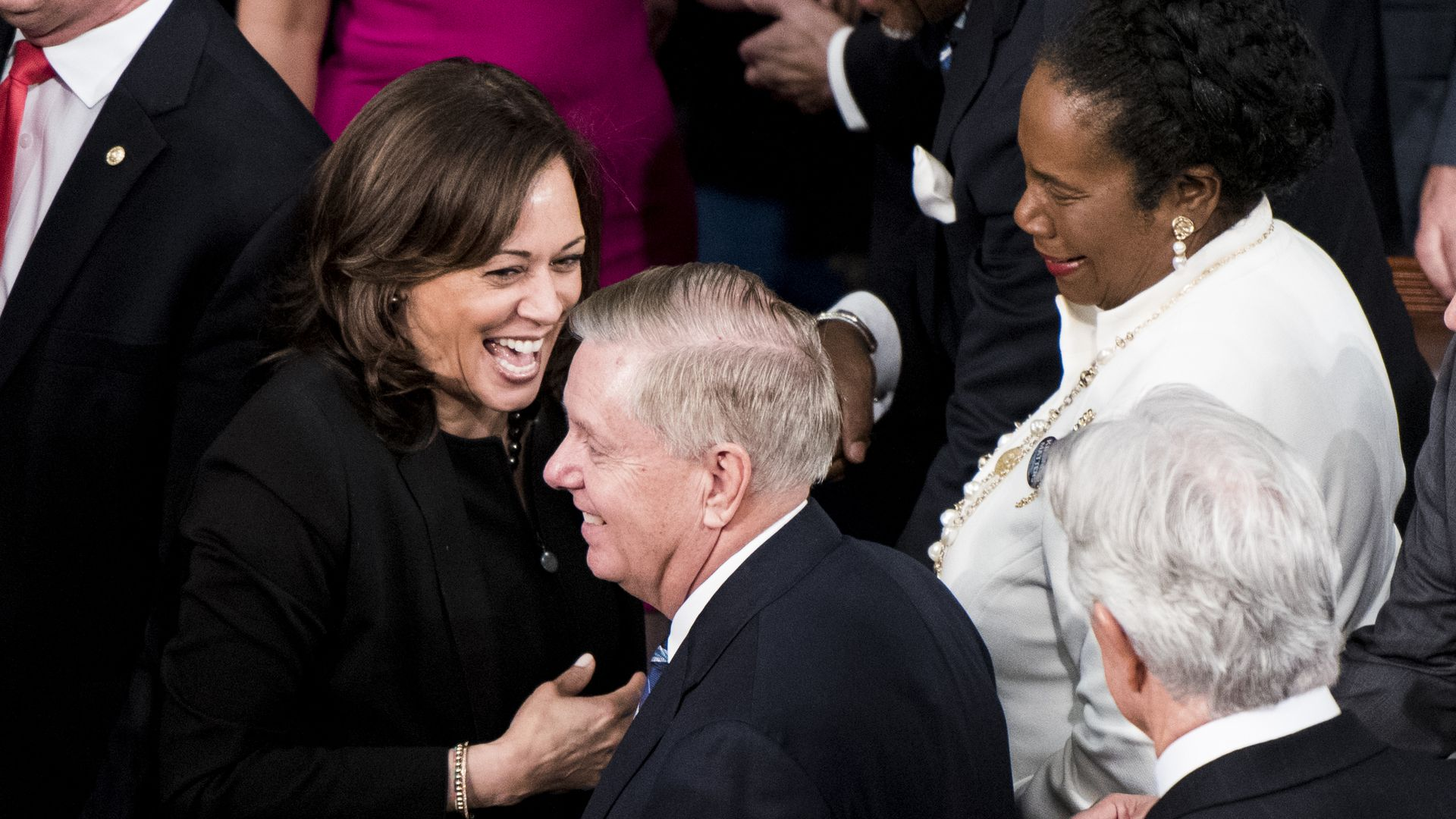 Sen. Kamala Harris, D-Calif., and Sen. Lindsey Graham, R-S.C., arrive for President Donald Trump's State of the Union Address to a joint session of Congress in the Capitol on Tuesday, Feb. 5.
