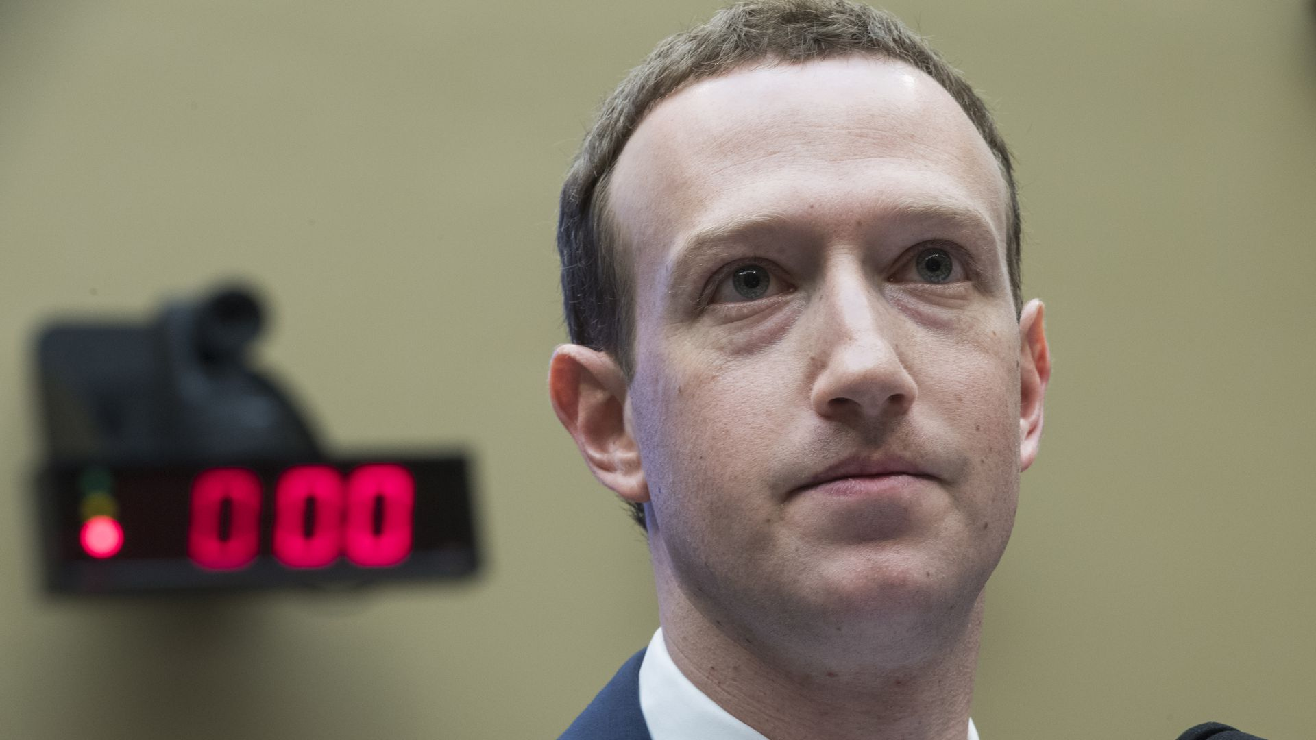 A closeup of a frowning Mark Zuckerberg