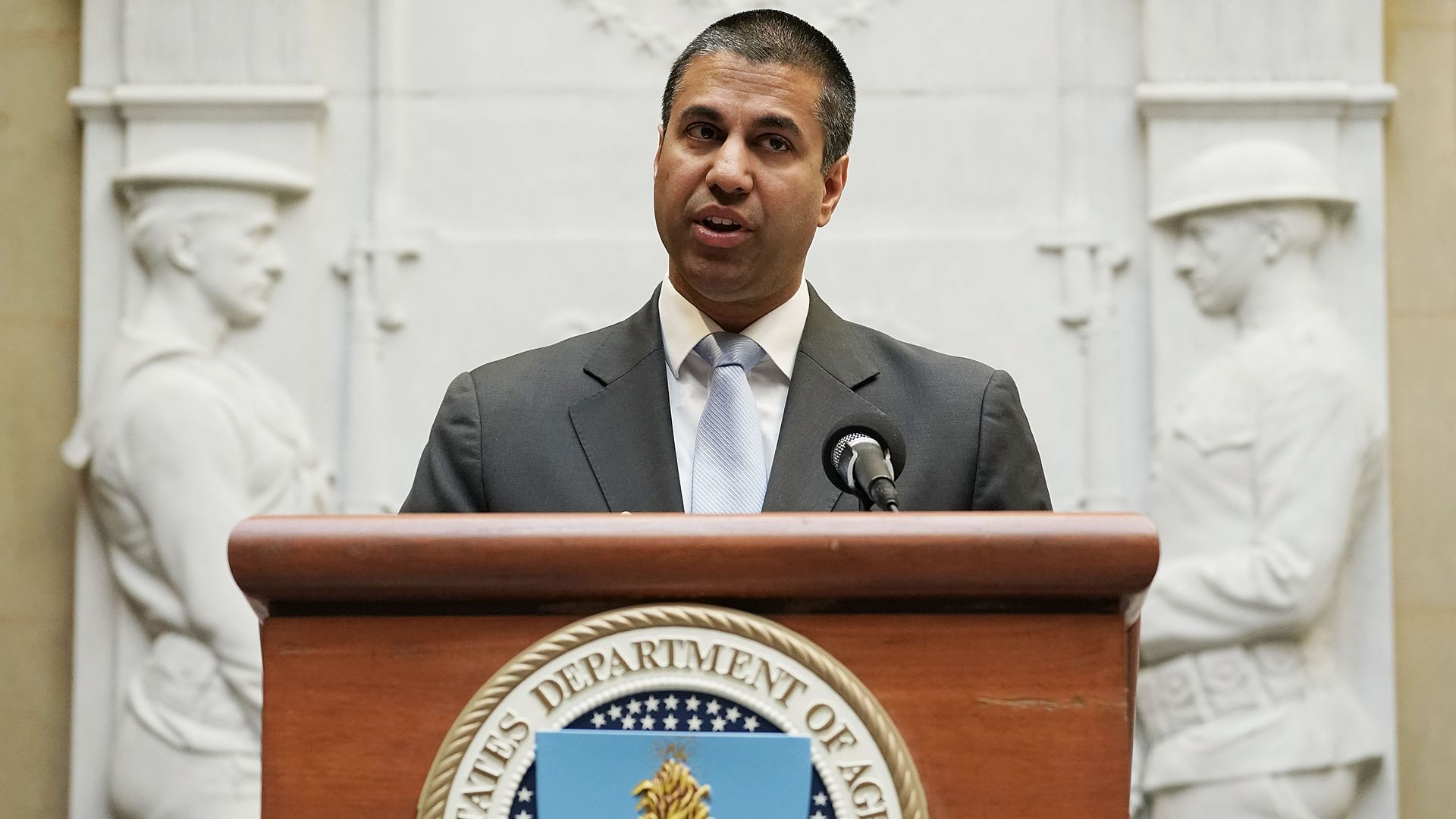 FCC Chairman Ajit Pai speaks behind a podium with the U.S. Department of Agriculture logo.