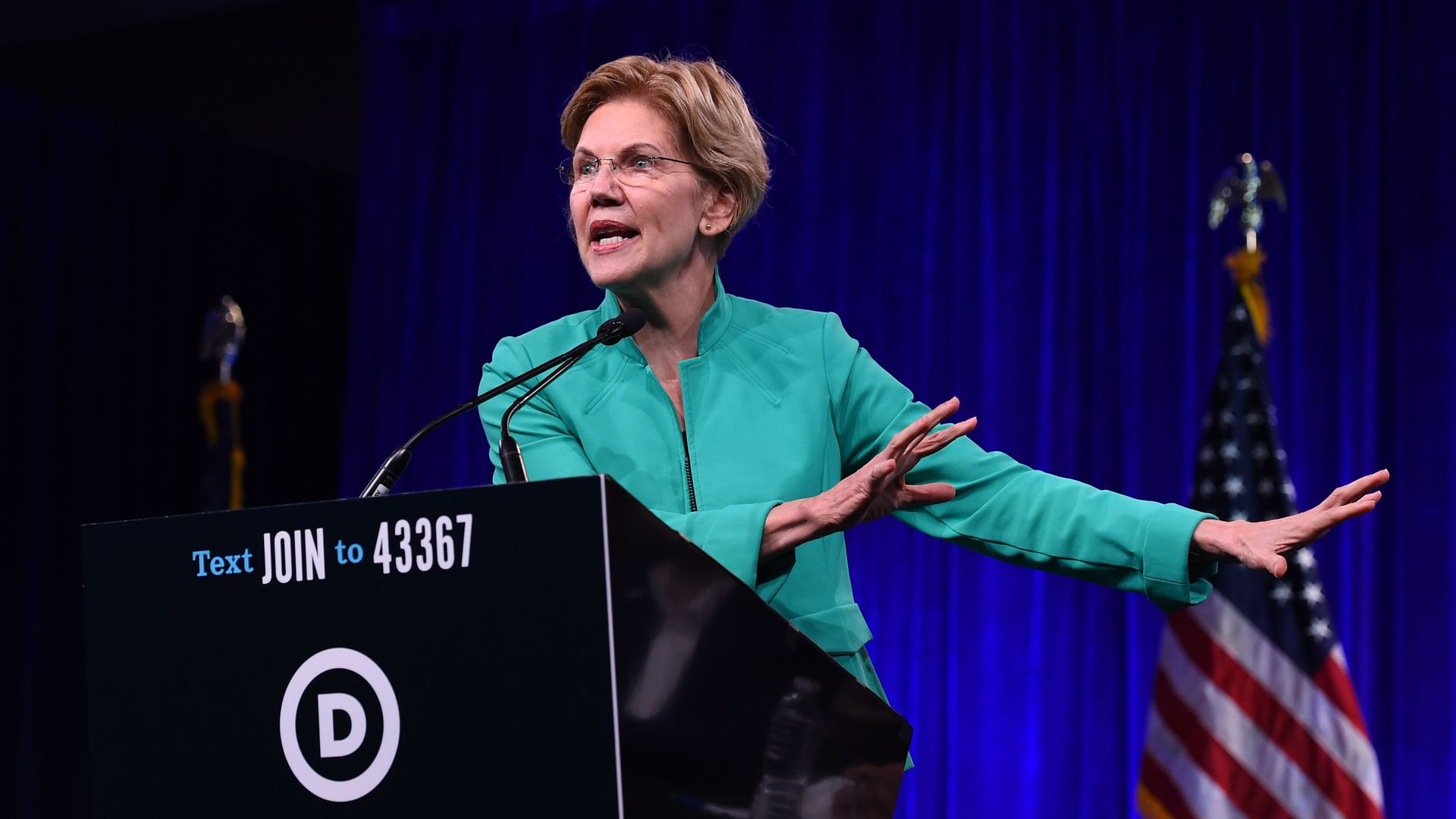 Democratic Presidential hopeful US Senator from Massachusetts Elizabeth Warren speaks on-stage during the Democratic National Committee's summer meeting in San Francisco